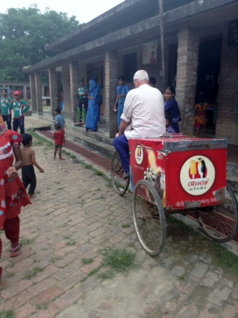 Ken is riding the ice cream cycle. The ice cream man cycled 8 miles to bring ice cream to Sreepur - a rare treat for everyone!