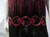 (detail) TUNIC-STYLE EVENING DRESS, silk net embroidered with glass bugle beads, rayon silk under-slip, circa 1921-23.