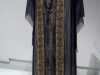 TUNIC-STYLE EVENING DRESS, cream silk under-dress with front panel embroidered in silk flock. Over-dress of black chiffon with gold metallic trim, made by Cosprop, 2012. Worn by Shirley MacLaine as Marthe Levinson in Downton Abbey.