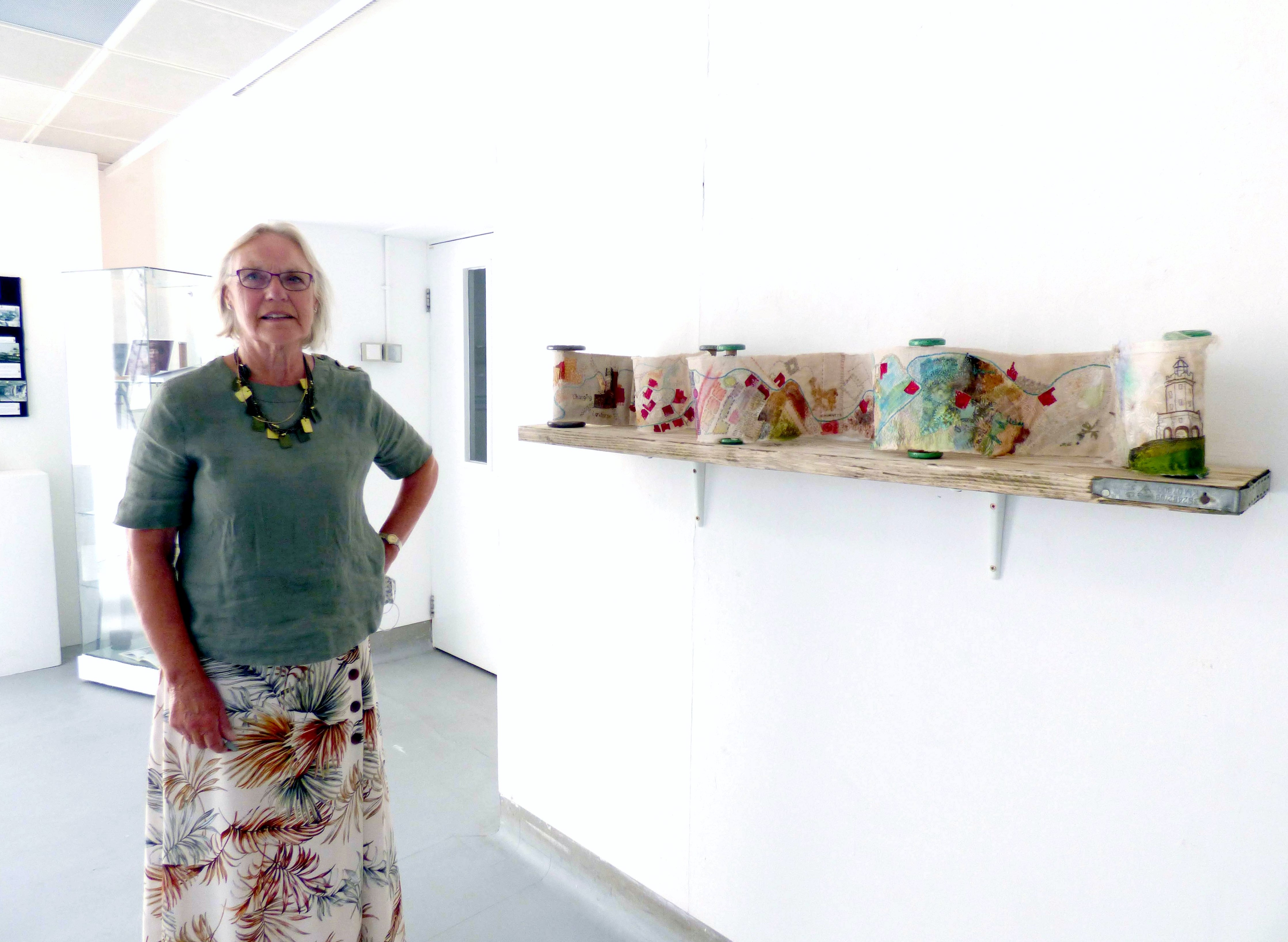 """CHANGING LANDSCAPE, Dunbar Mill, Blackburn by Sue Reeve, fabric collage, hand embroidery and old bobbins, """"Synergy"""" exhibition by Preston Threads, July 2021"""