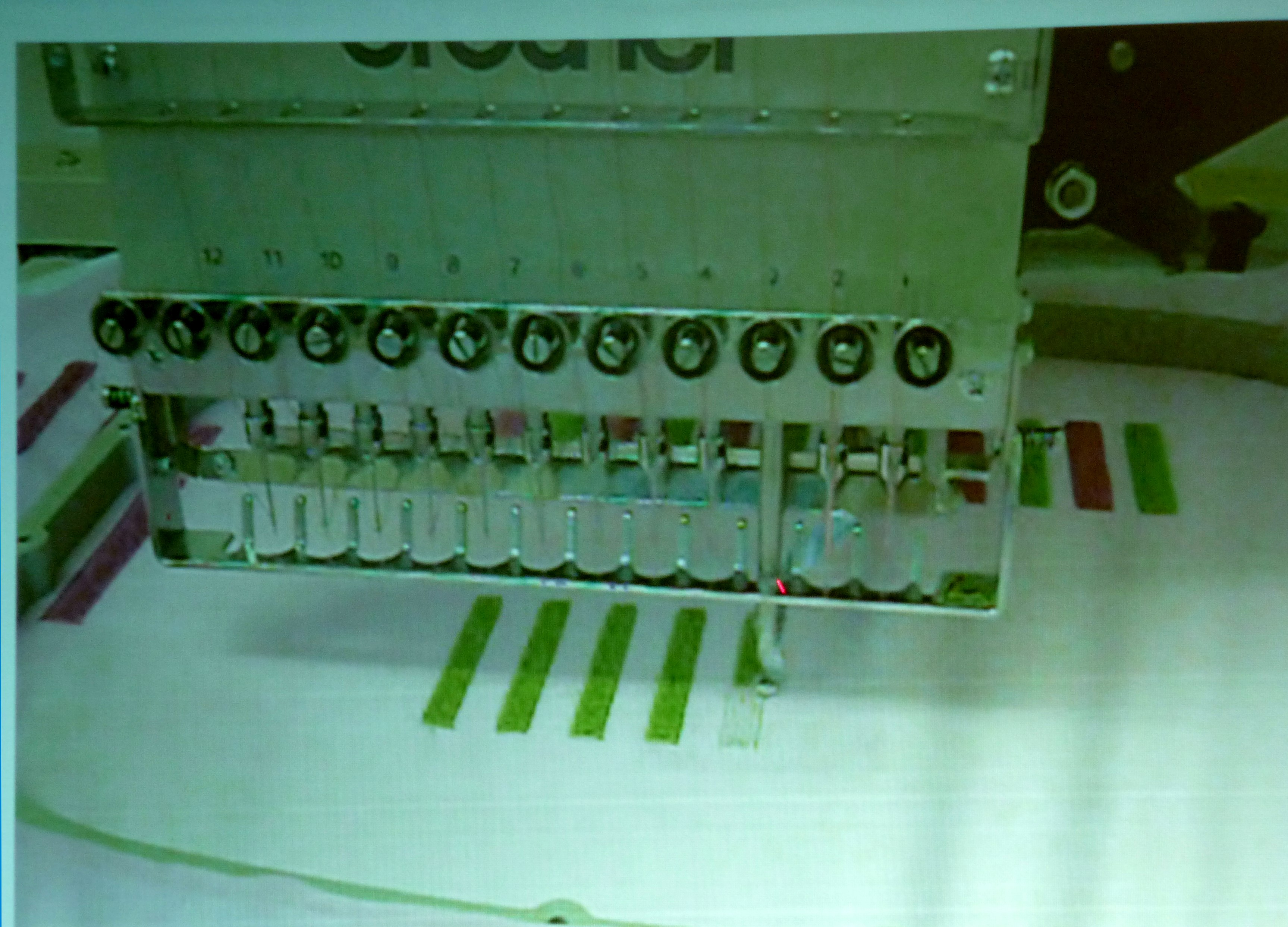 slide by Alice Colson showing 12 needle sewing machine