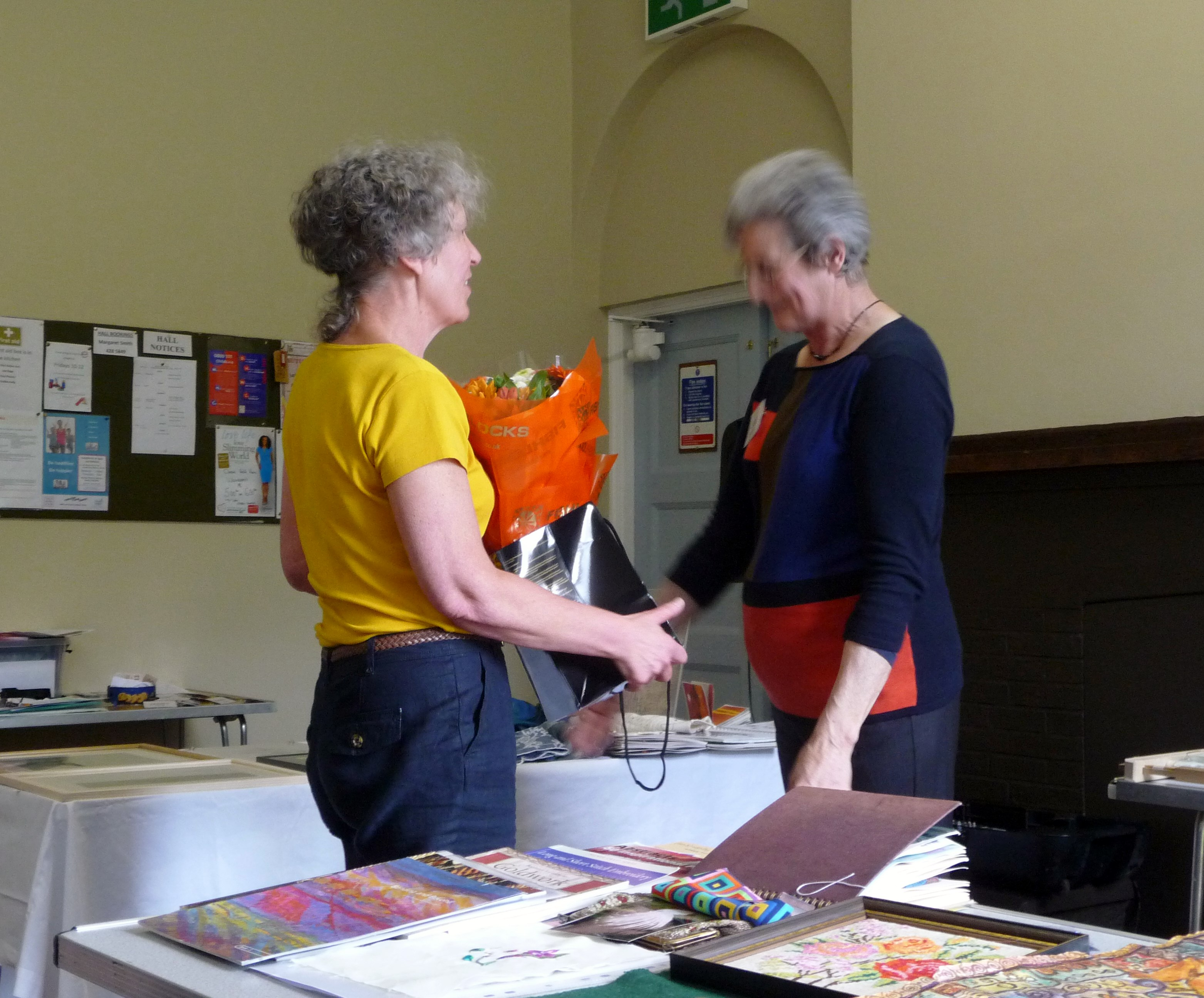 Janet receiving a bouquet from Kim, in apprectiation of her work towards MEG Bursary