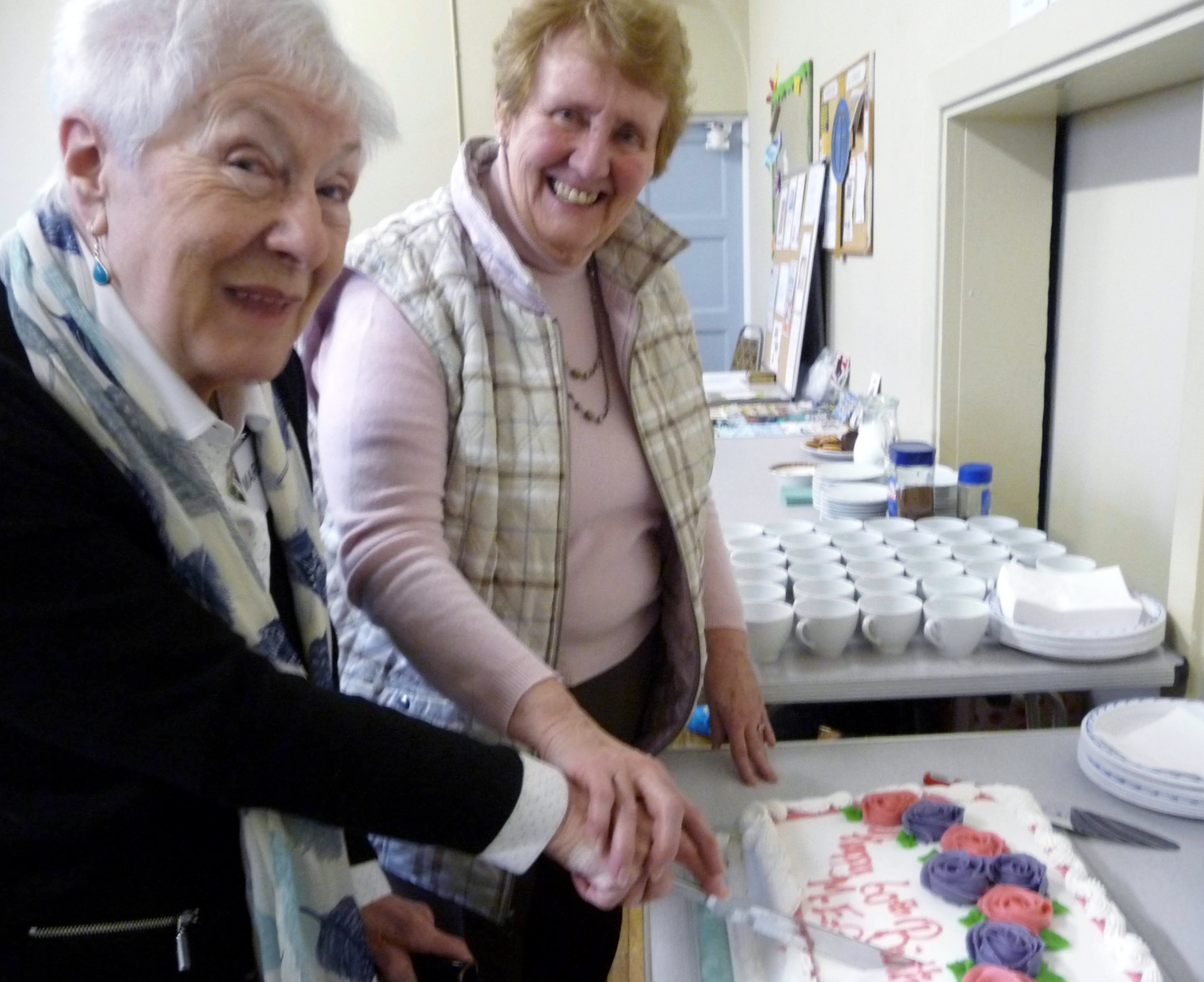 Margaret Gold, one of Merseyside E.G.'s longstanding members, and Beryl Webster, our newest member, cut the 60th Anniversary cake