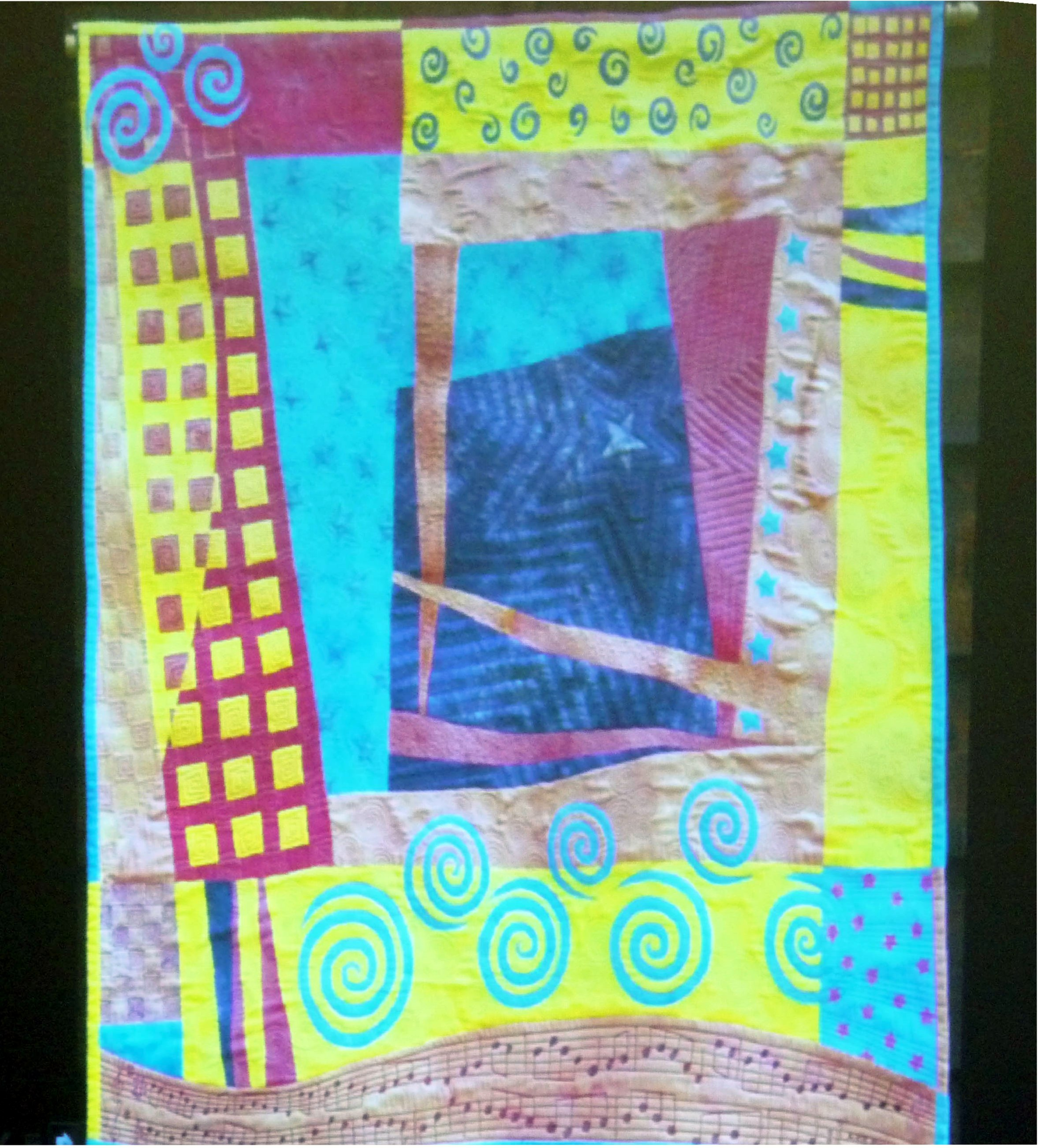 slide by Bobby Britnall showing a quilt with a musical influence
