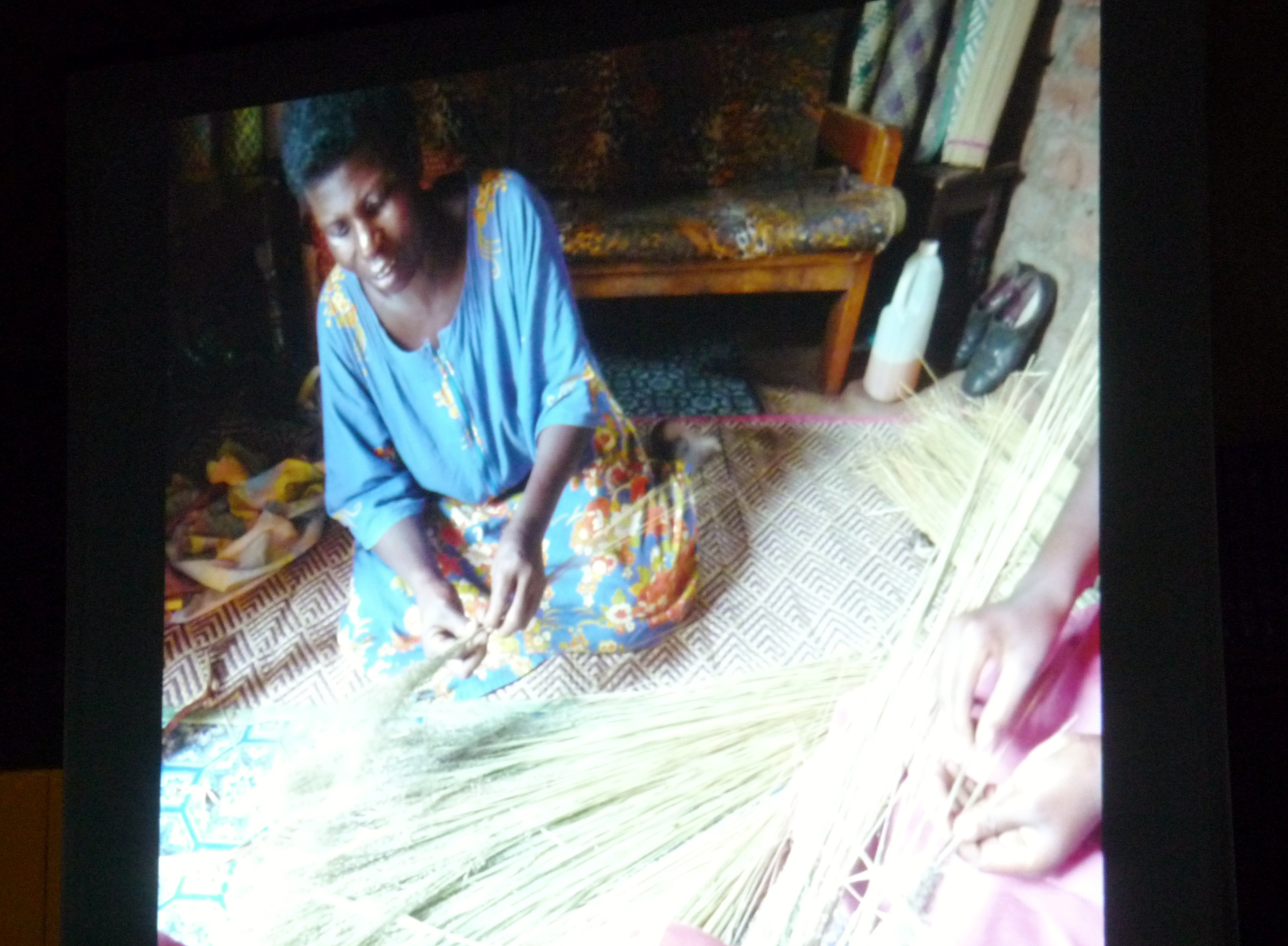 slide by Bobby Britnall showing a Ugandan woman making a broom