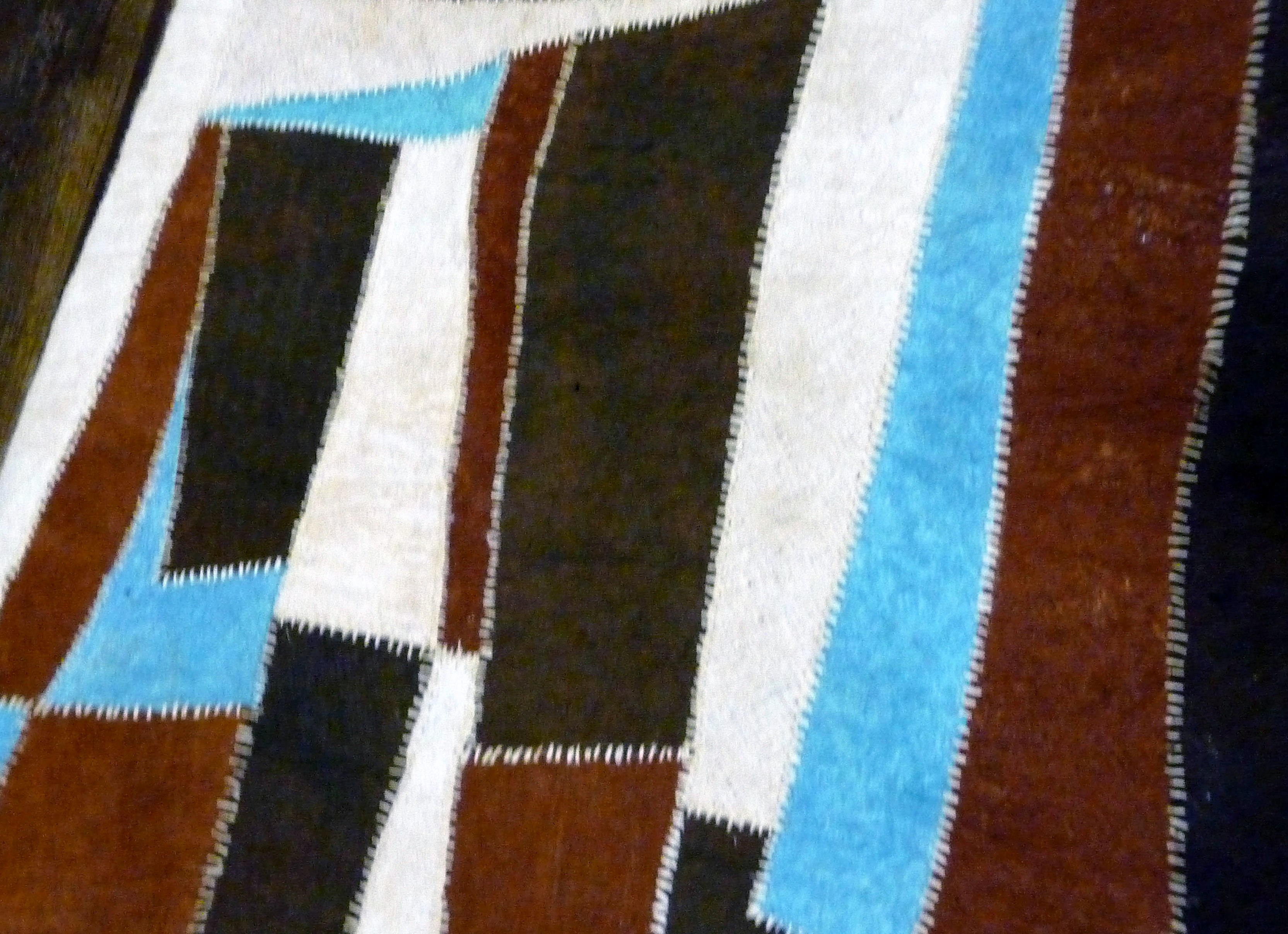 slide by Bobby Britnall showing strips of barkcloth sewn together