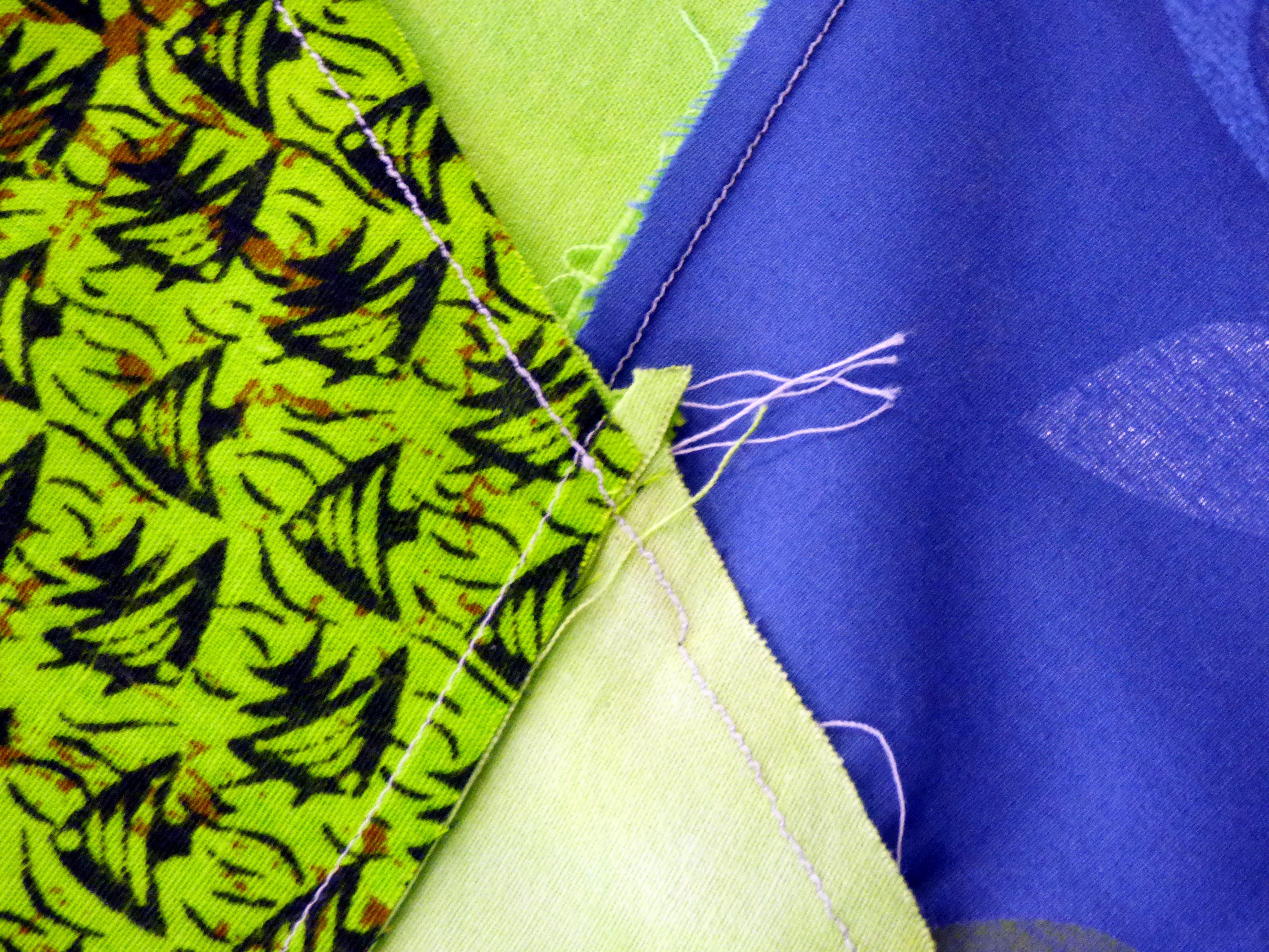 (close up of reverse showing seams lying correctly) Margaret Smith gave us some lessons on quilt construction. This is how the KF quilt block should be sewn