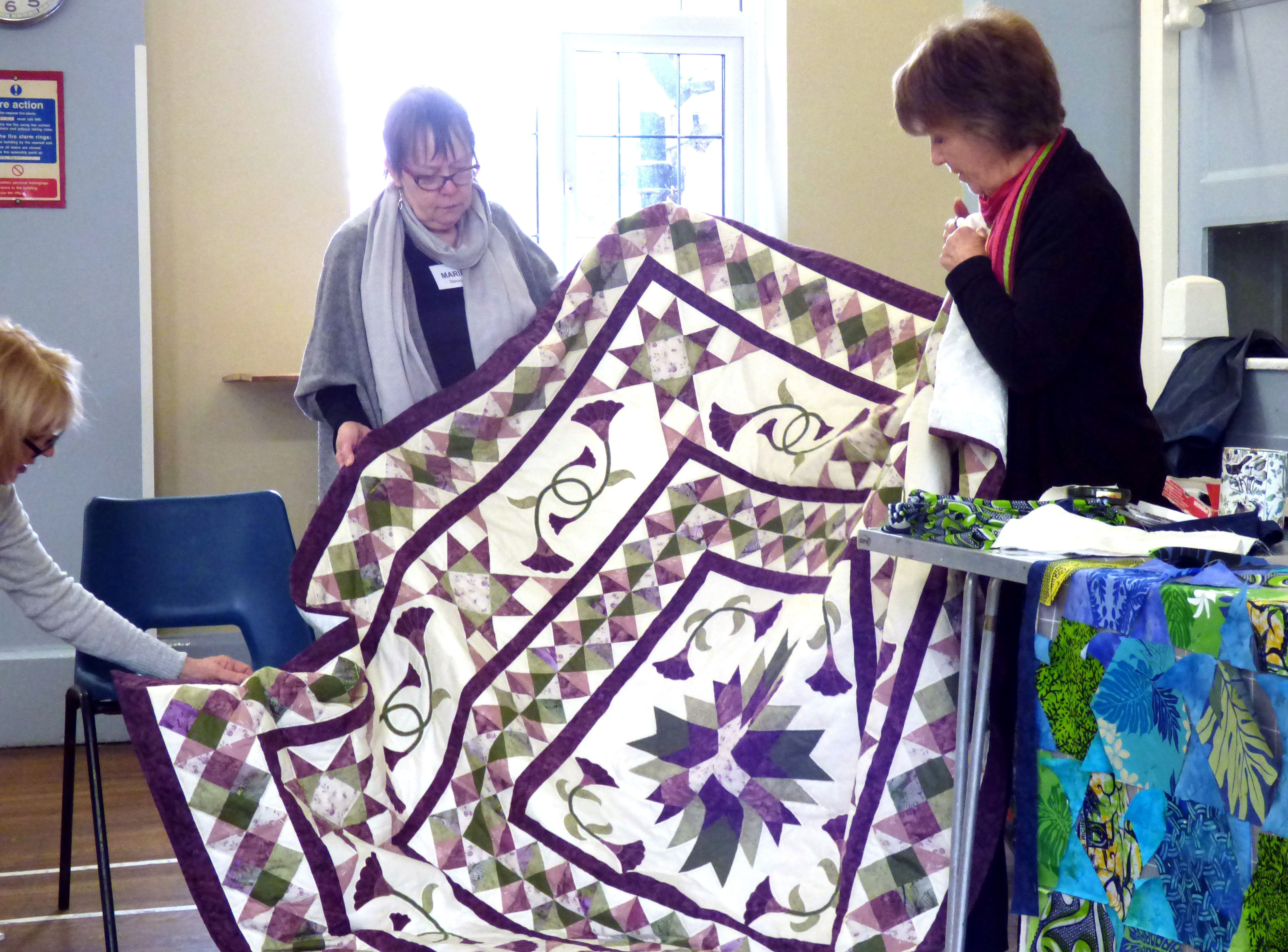 Margaret Smith with a quilt she made and hand quilted
