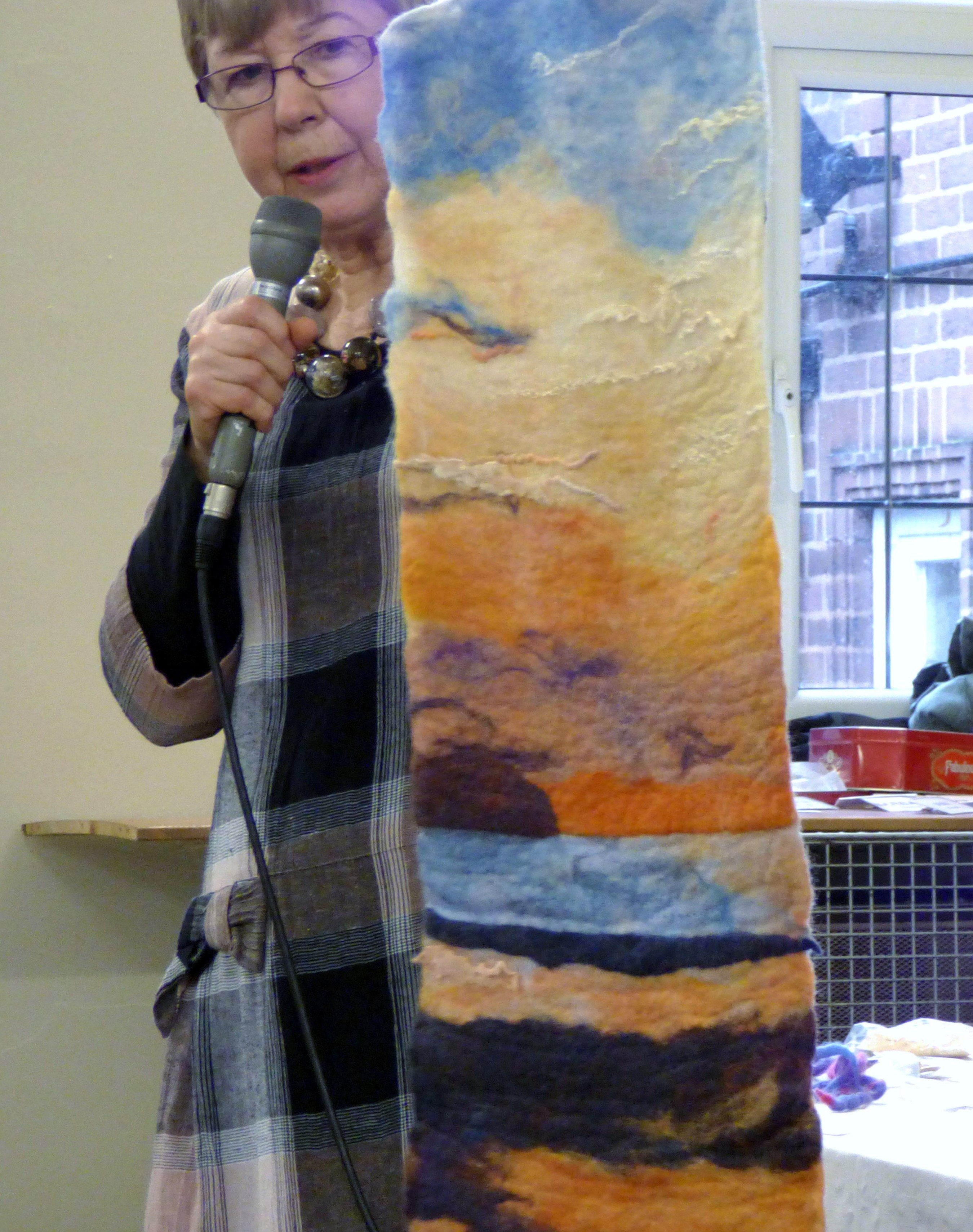 Ronny White with a felt weaving of a sunset, N.Wales EG