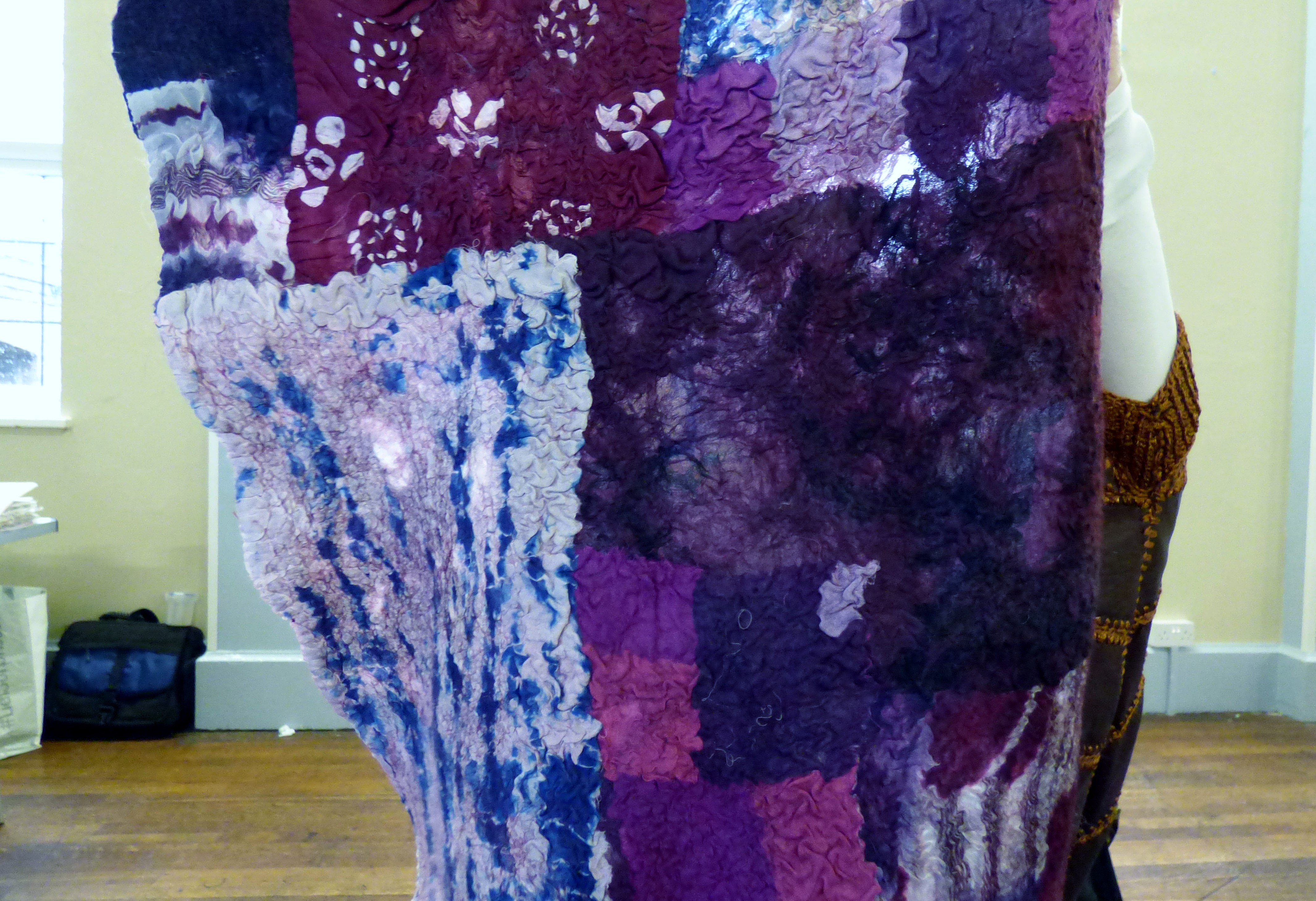 detail of nuno felt scarf on a backing of polyester scarves by Ronnie White, N.Wales EG
