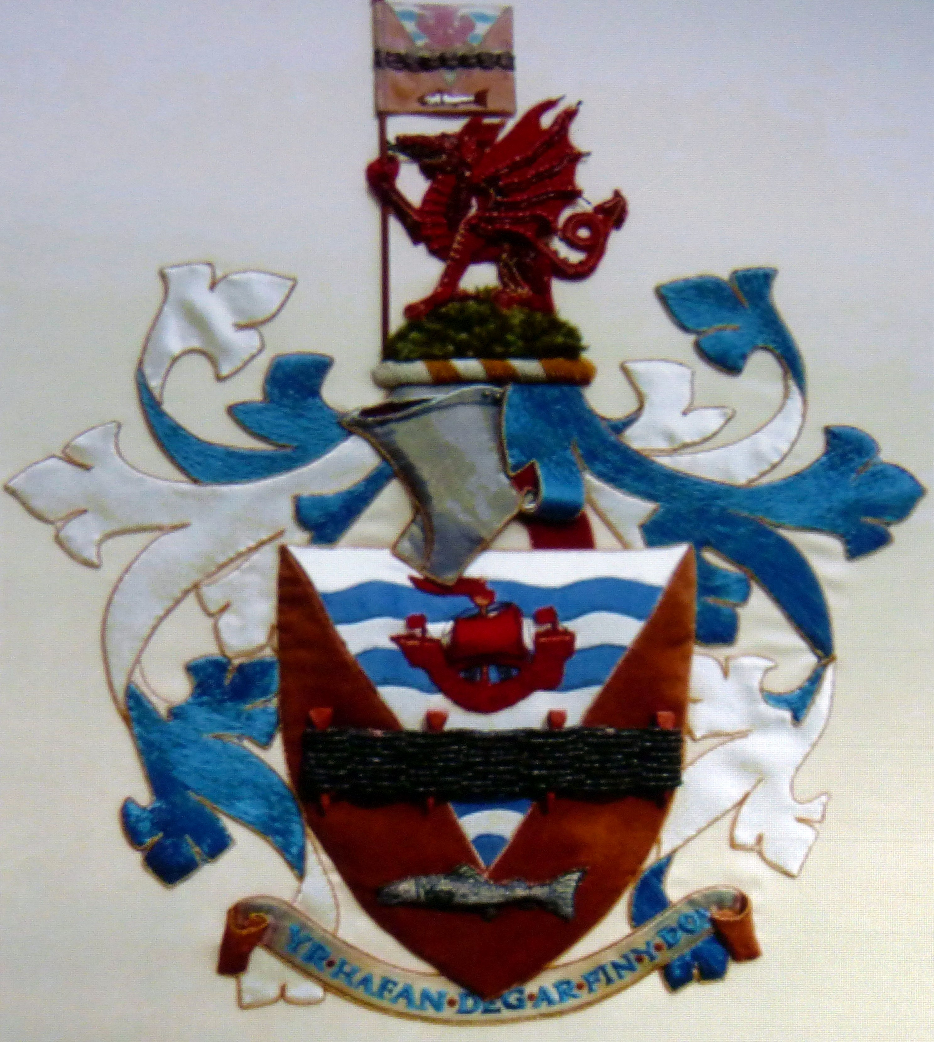 slide showing Rhyl coat of arms embroidered by Moya McCarthy and members of N.Wales EG