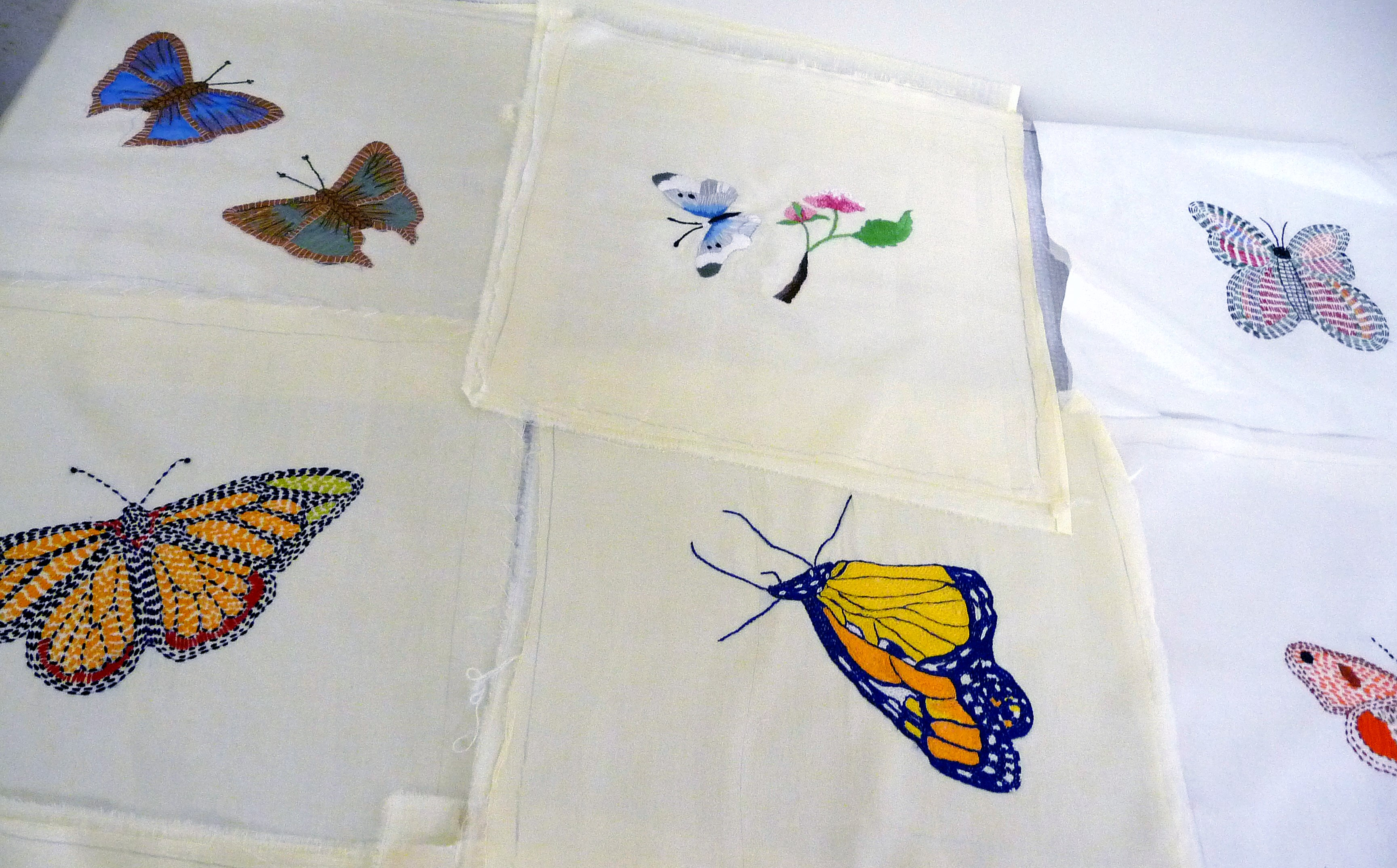 butterfly design kantha embroidery. Ruby Porter MBE will join these squares together to make a quilt to aid her Sreepur charity