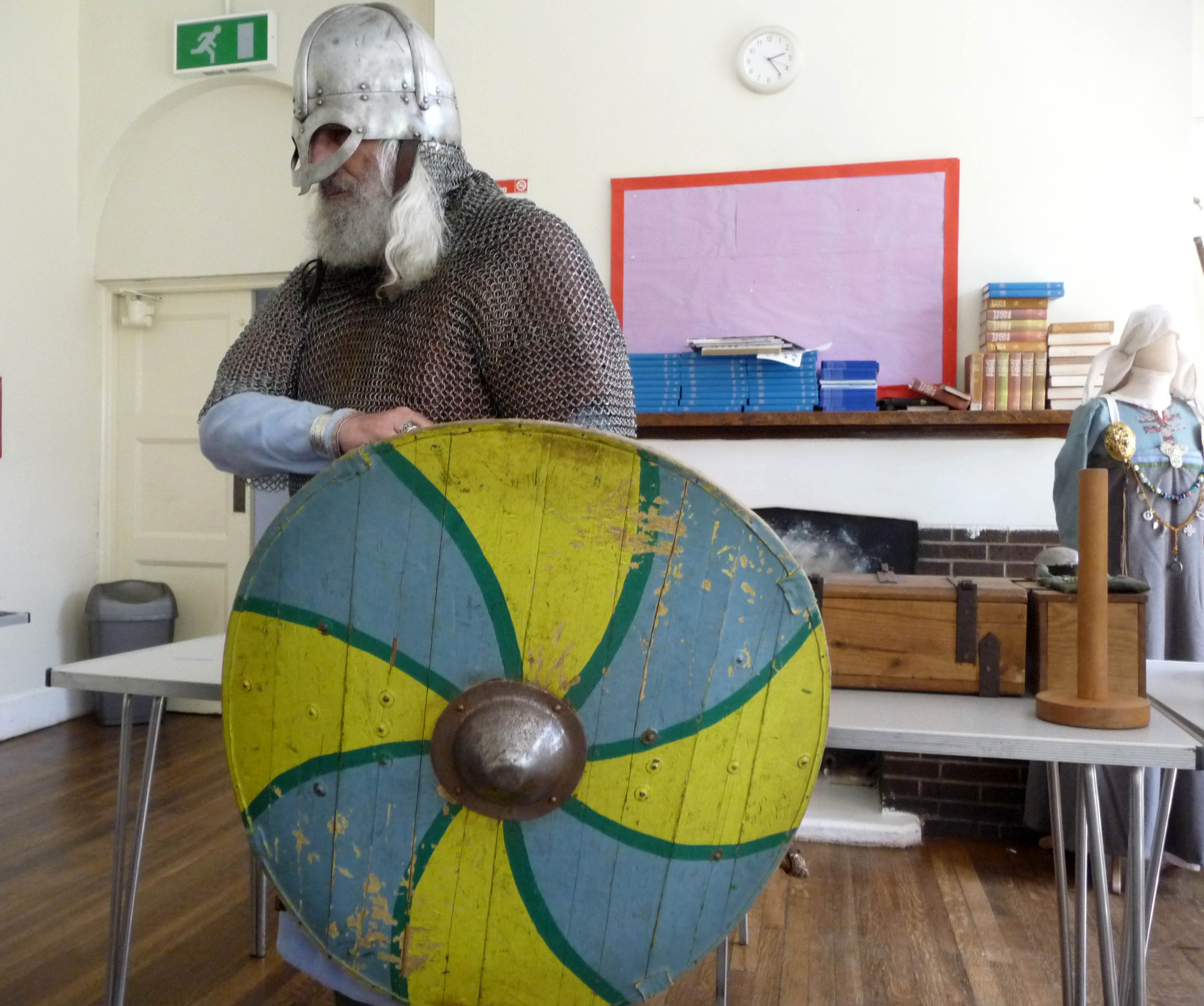 Snorri the Viking entered wearing chainmail and helmet and carrying a shield