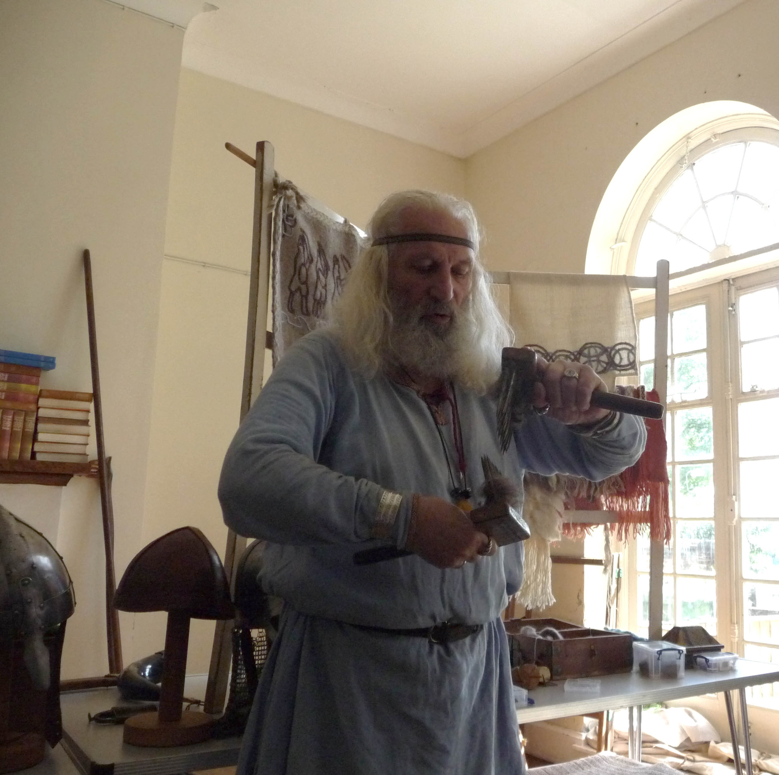 Snorri the Viking is demonstrating how the wool would be combed before spinning