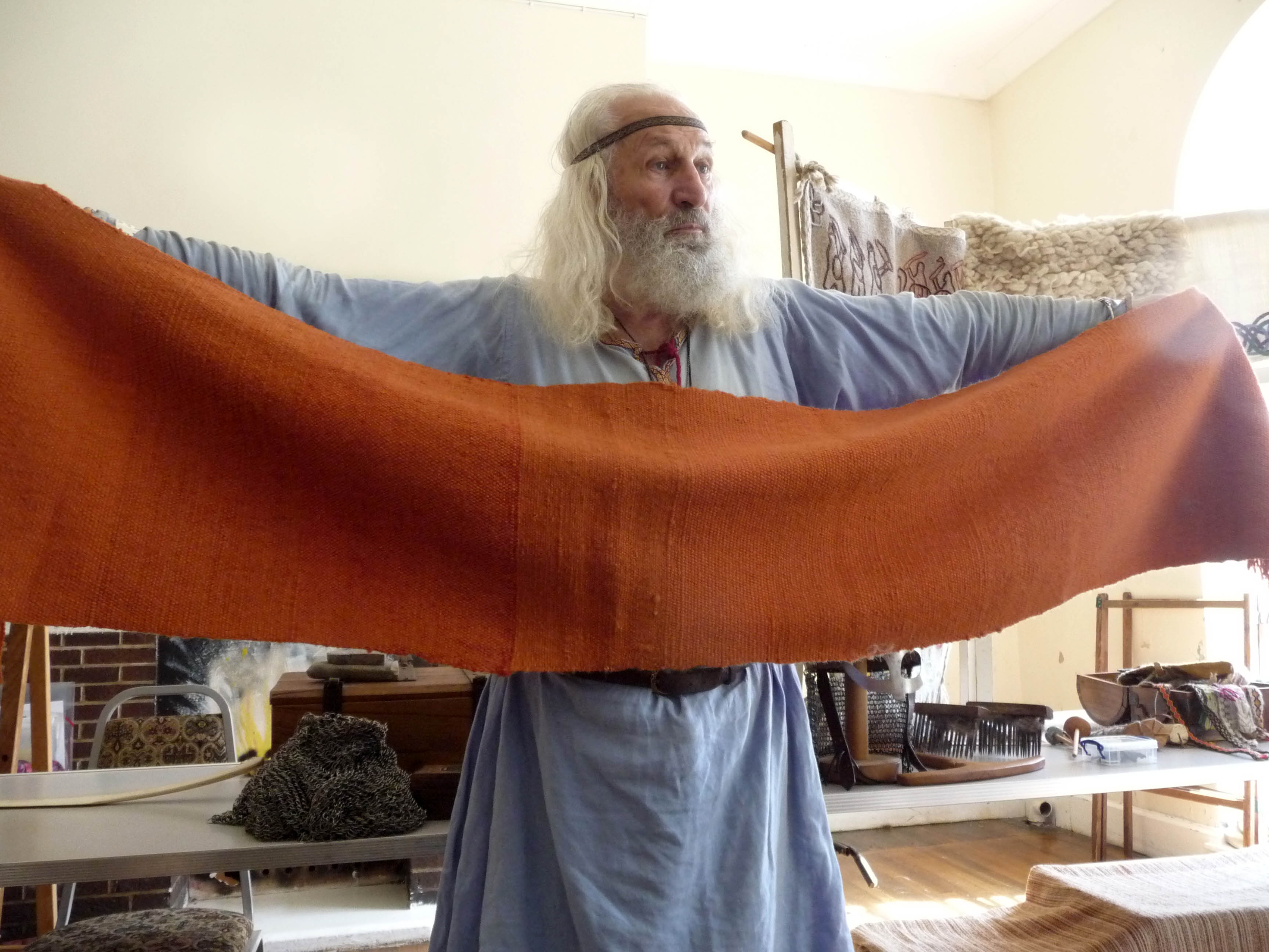 this is a scarf which was made by shearing, dyeing, spinning and weaving. It took three years to make.