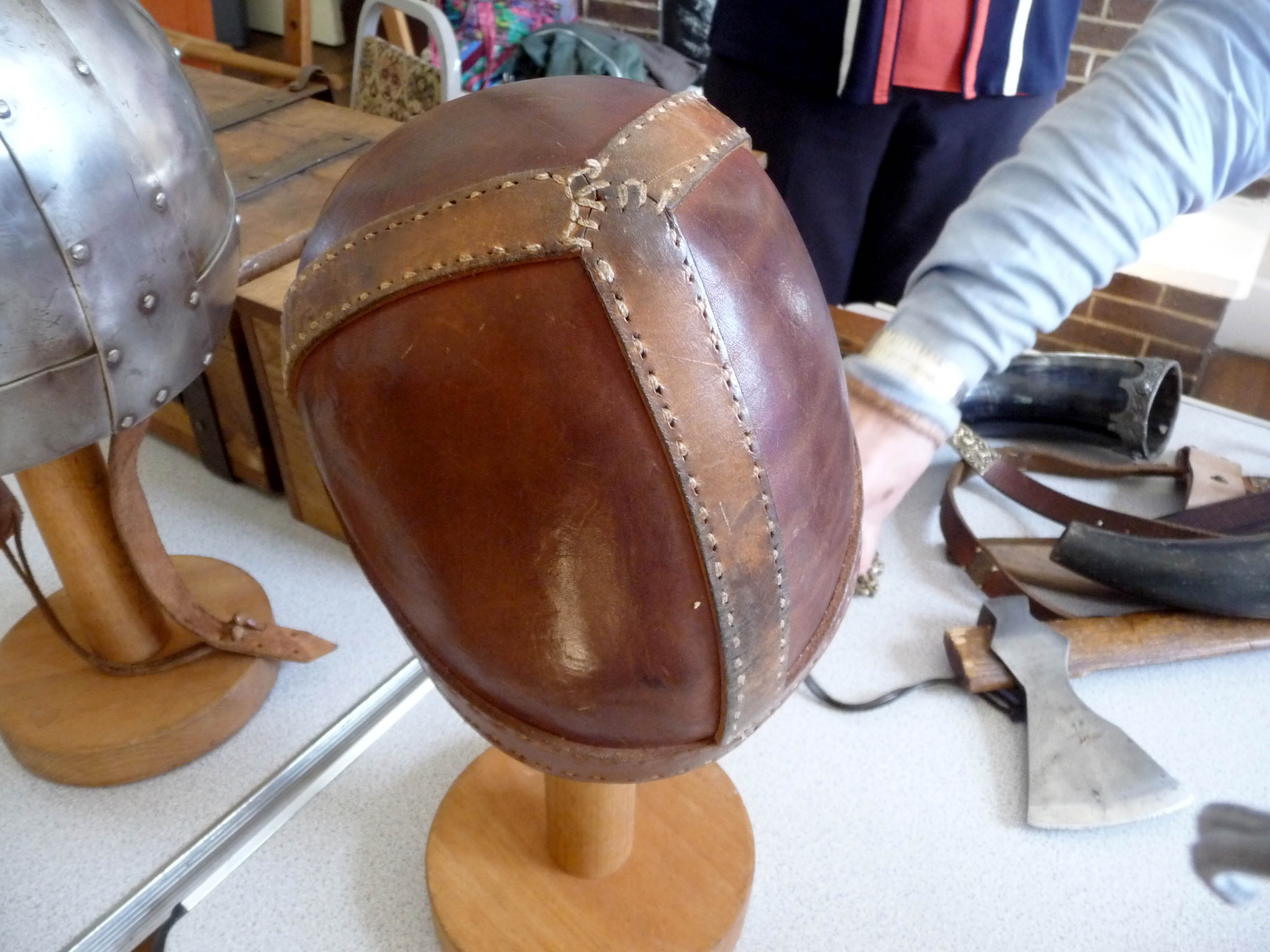 a leather Viking helmet which was hand sewn by Snorri the Viking