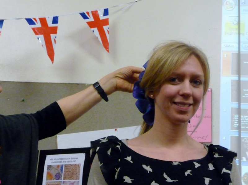 Nawal shows Gemma how the hair ornament would look