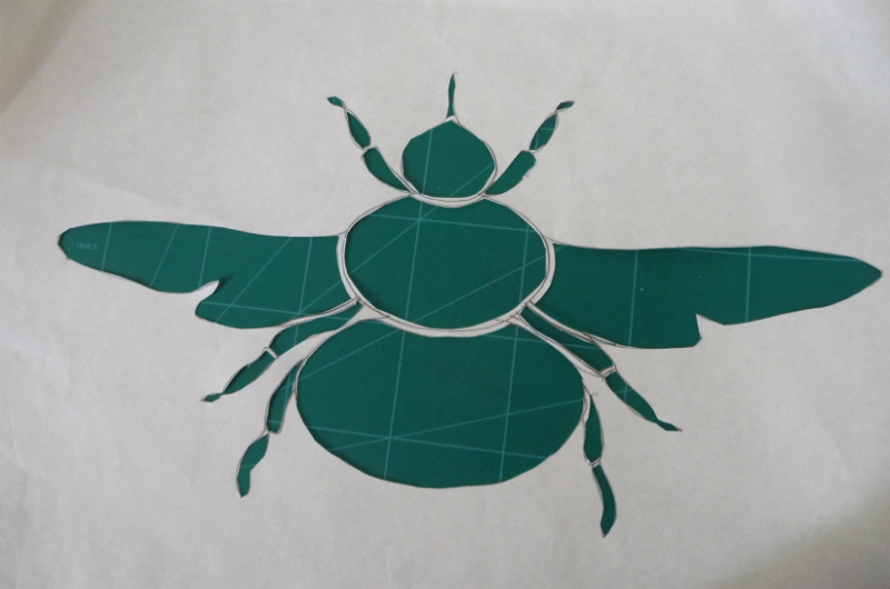 Paper stencil cut ready for screen printing