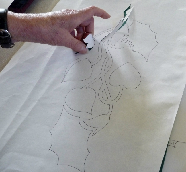 paper pattern with stencil being cut