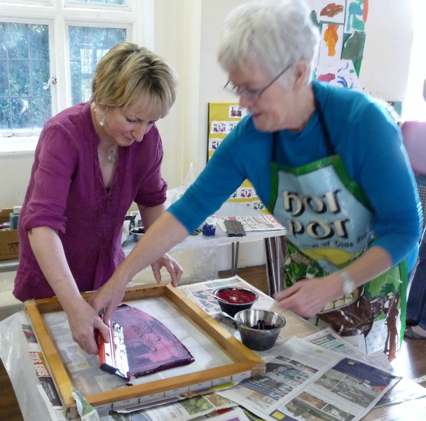 Elsie is showing Sarah how to print her fabric