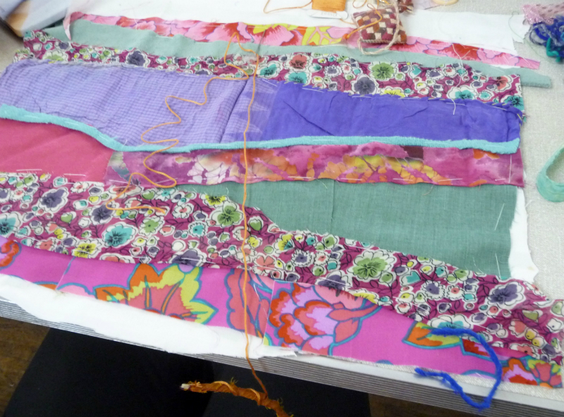one of the group beginning a piece with manipulated fabric