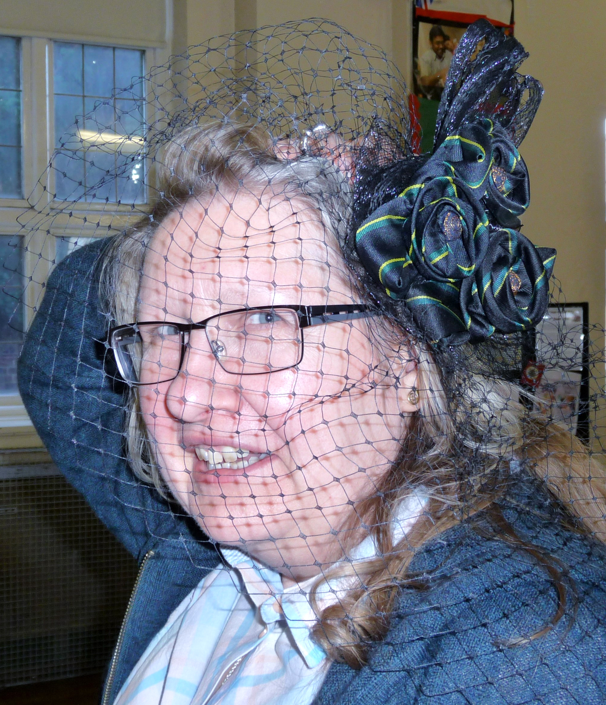 """""""The Ties That Bind Us"""" neck-tie Challenge competition - Gill Roberts is modelling a fascinator embellished with old school ties"""