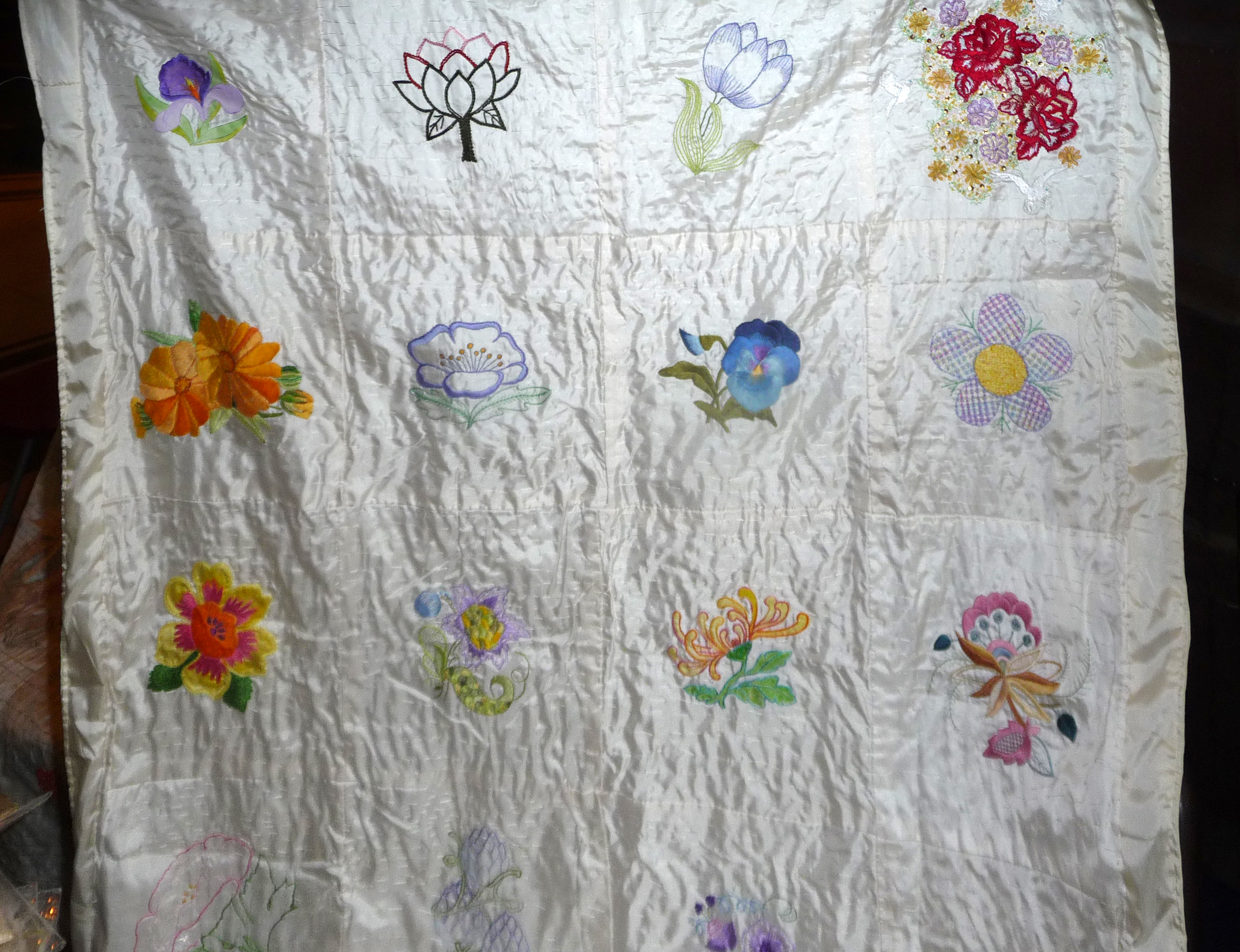embroidered flower squares made by Altrincham EG, kantha quilting by women of Sreepur Village