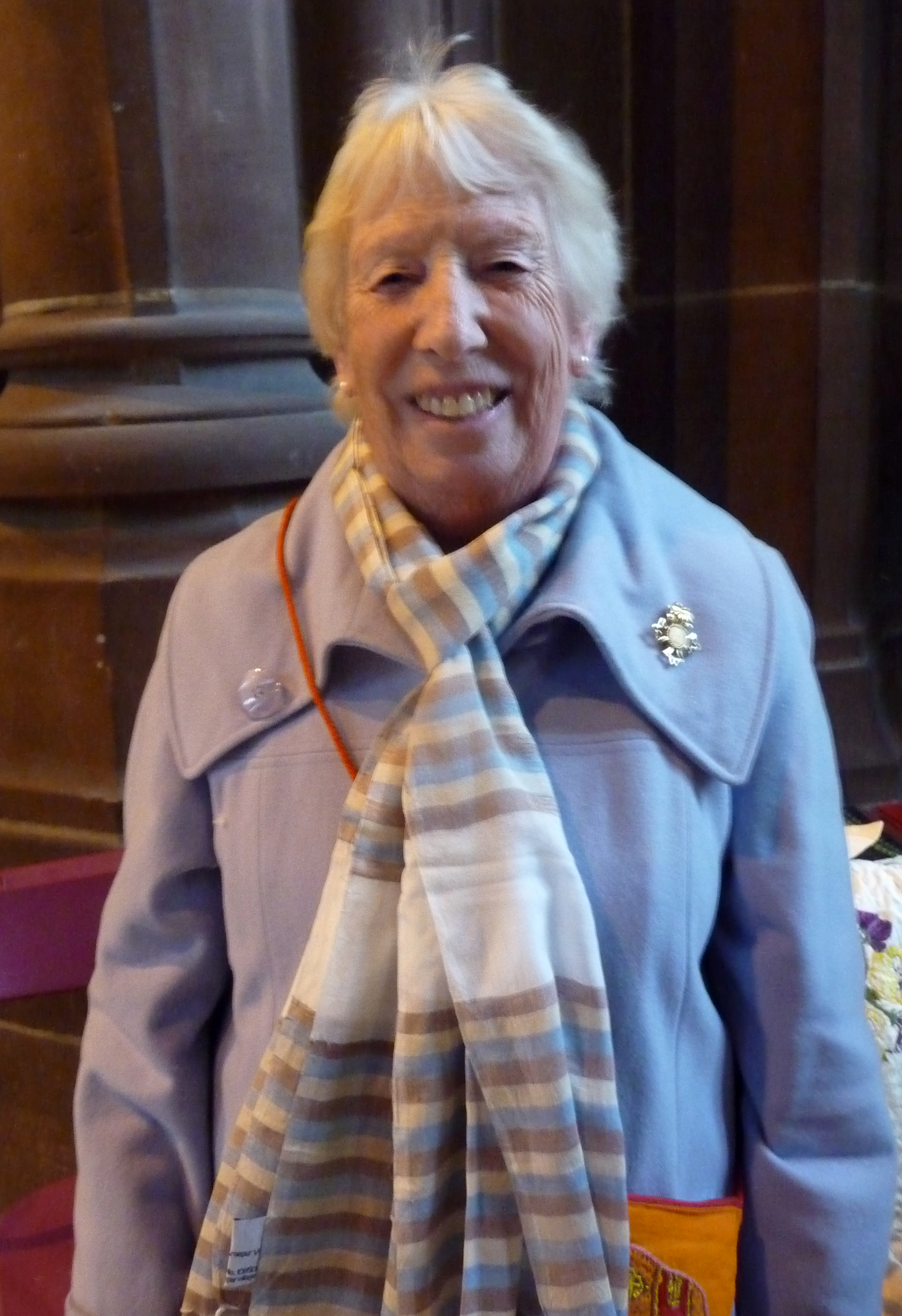 Rubina Porter MBE wearing a gassed cotton scarf, a new line from Sreepur