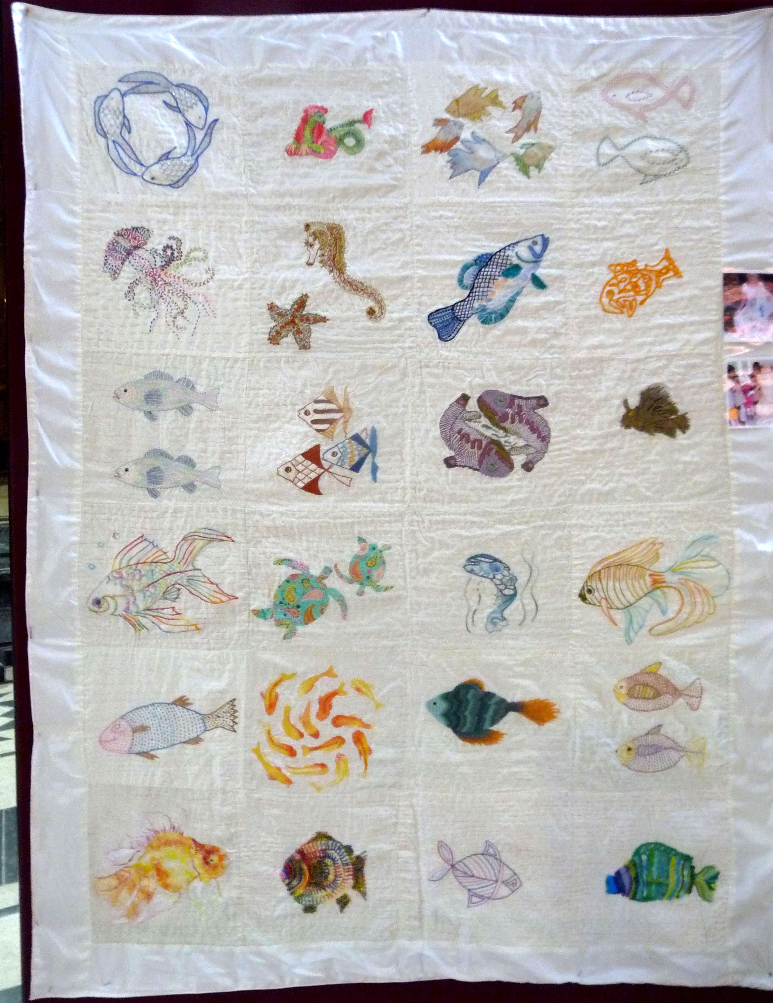 """kantha quilt with fish embroidered by Members of Merseyside Embroiderers Guild at """"Threading Dreams""""  Sreepur exhibition"""