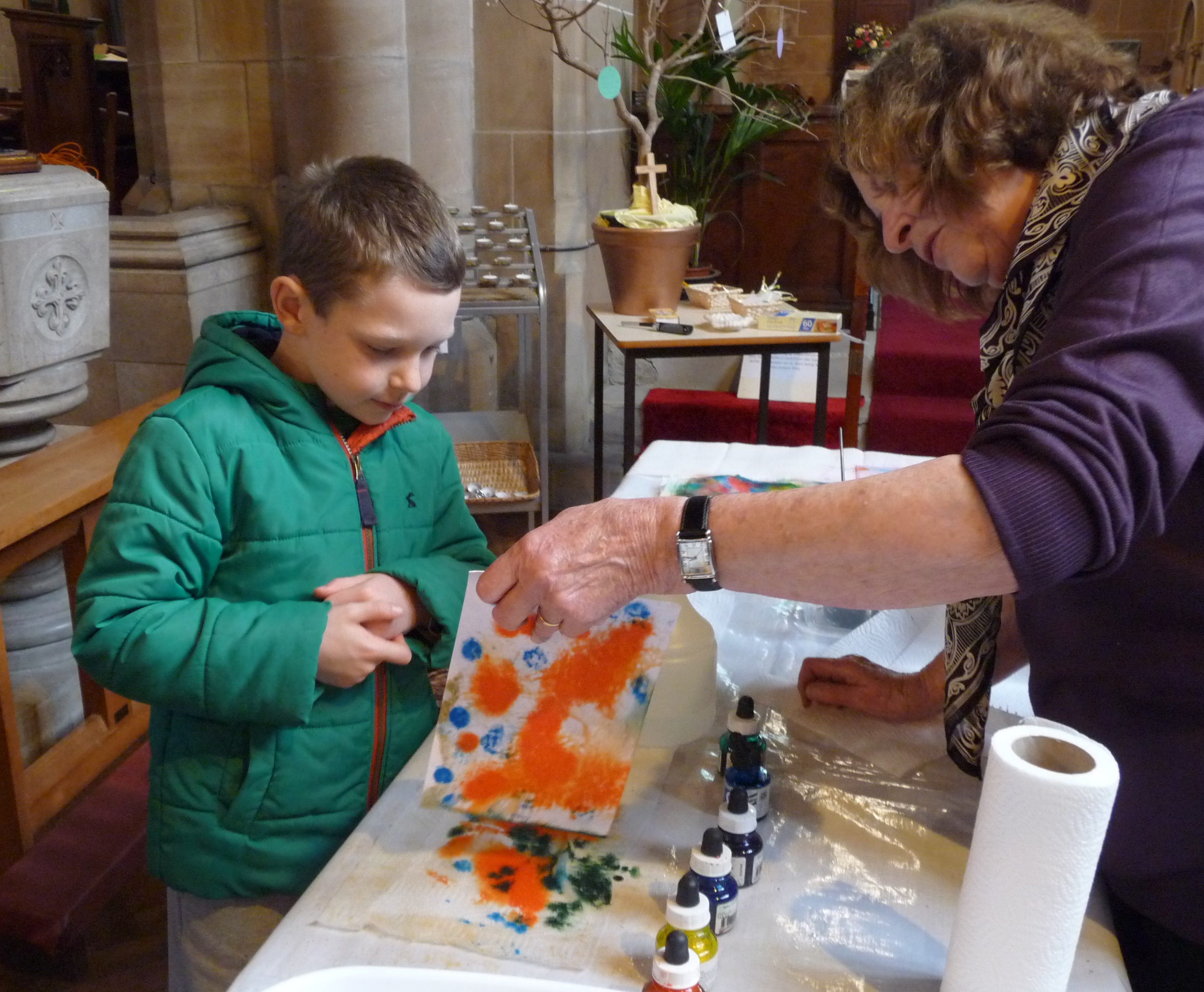 Norma Heron is helping a budding artist at the children's craft afternoon in St. Barnabus Church