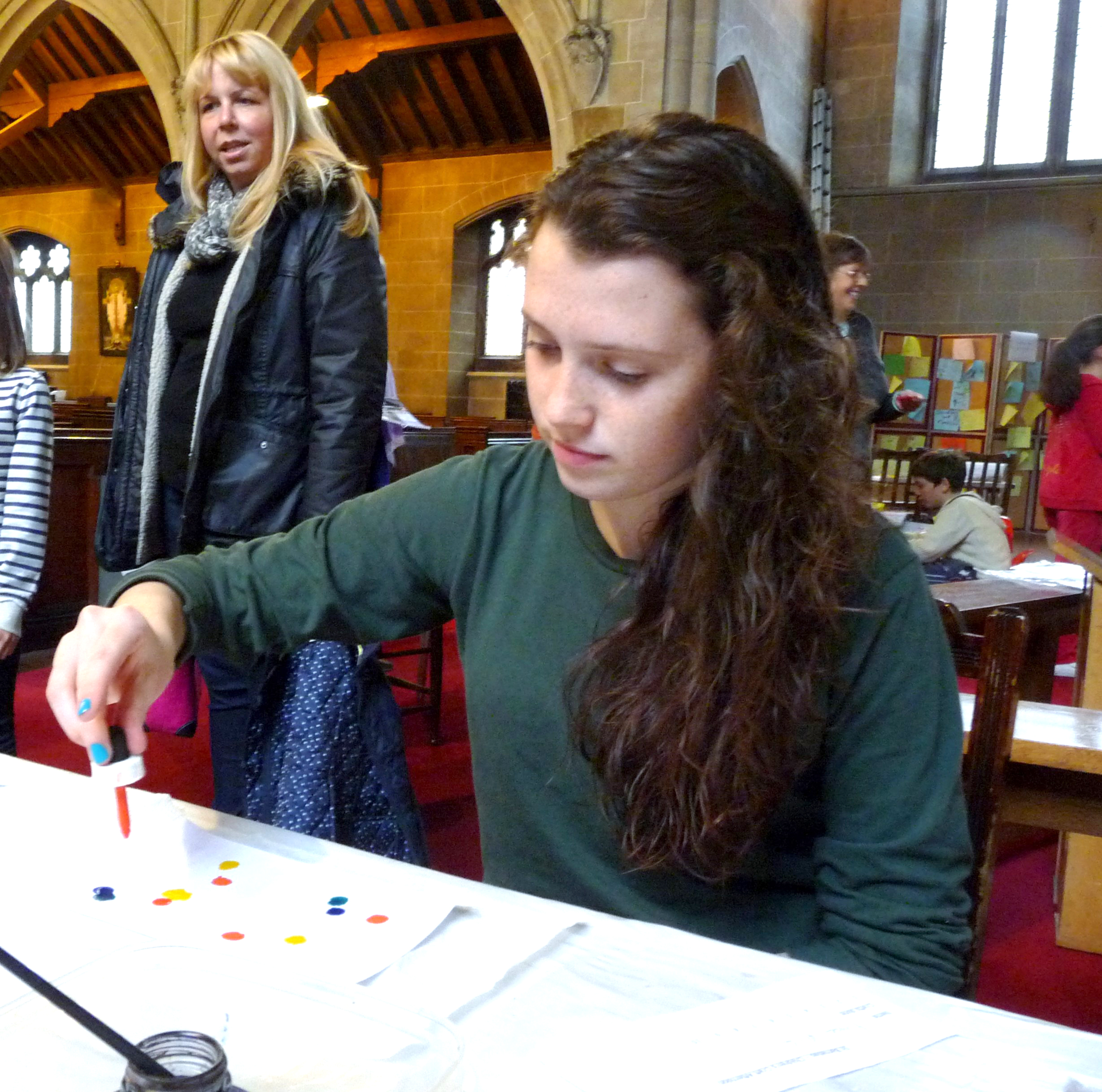Fern begins an artwork at the children's craft afternoon in St. Barnabus Church