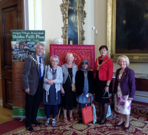Liverpool Lord Mayor Roz Gladden with Lord Mayor's Consort Roy Gladden and Taslima. a textile artist from Manchester who has a large collection of kanthas, at Threading Dreams exhibition 2016 in Liverpool Town Hall