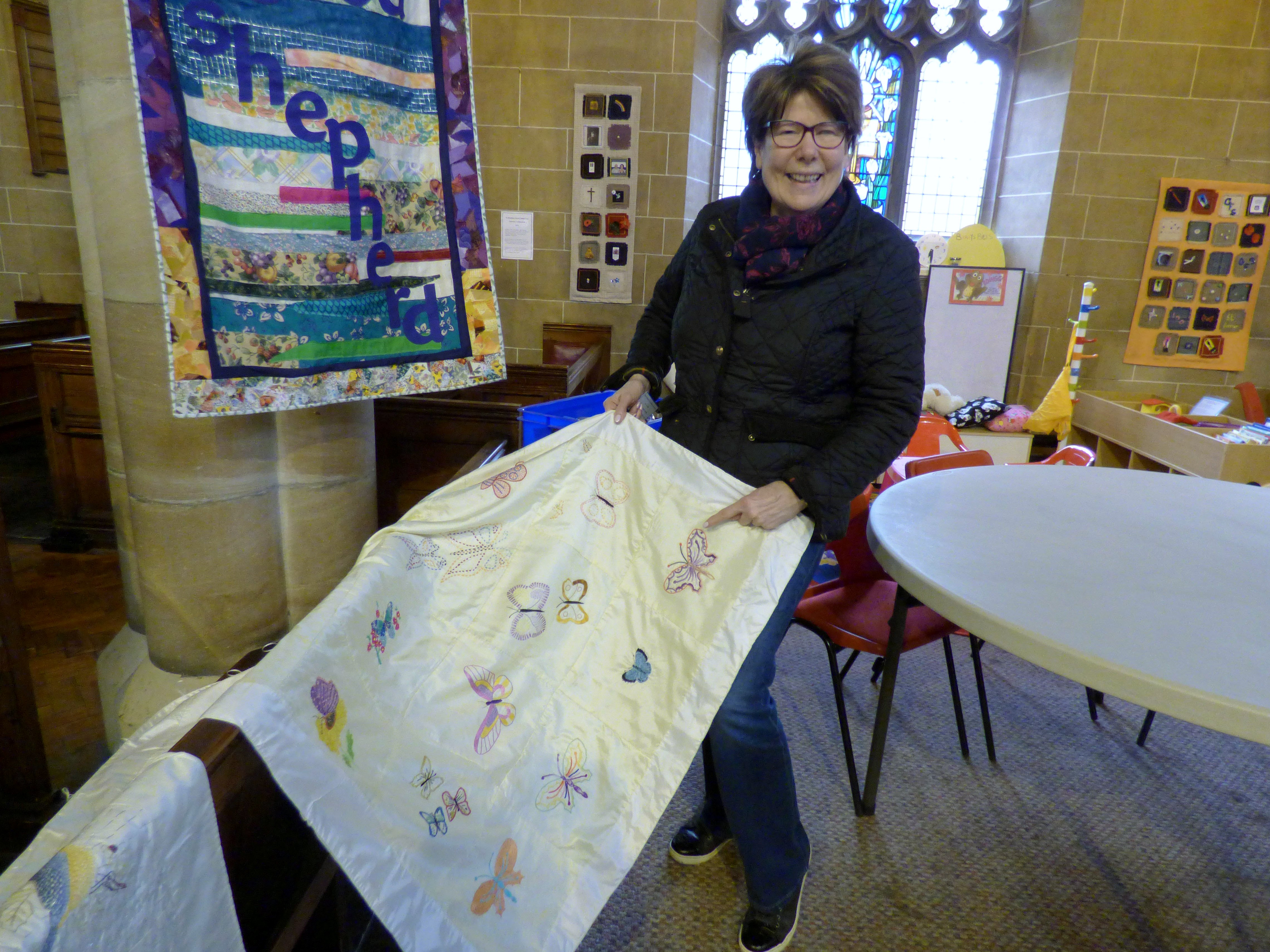 This is Sue who embroidered a butterfly for Ruby Porter's Sreepur quilt. She has never embroidered before- good work Sue!