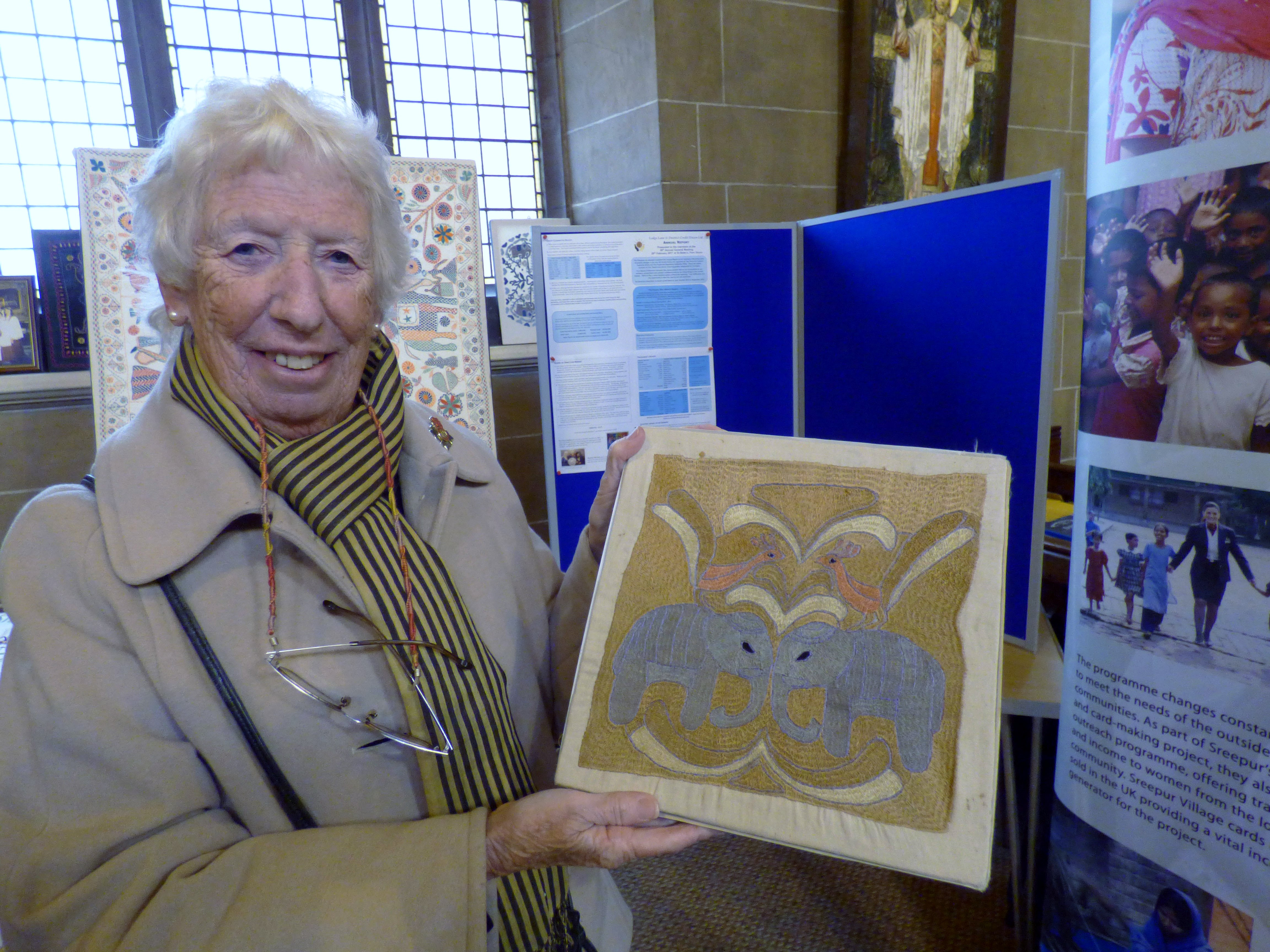 Ruby Porter MBE with embroidery in Kashmiri stitch at Threading Dreams exhibition, St Barnabus church, Penny Lane