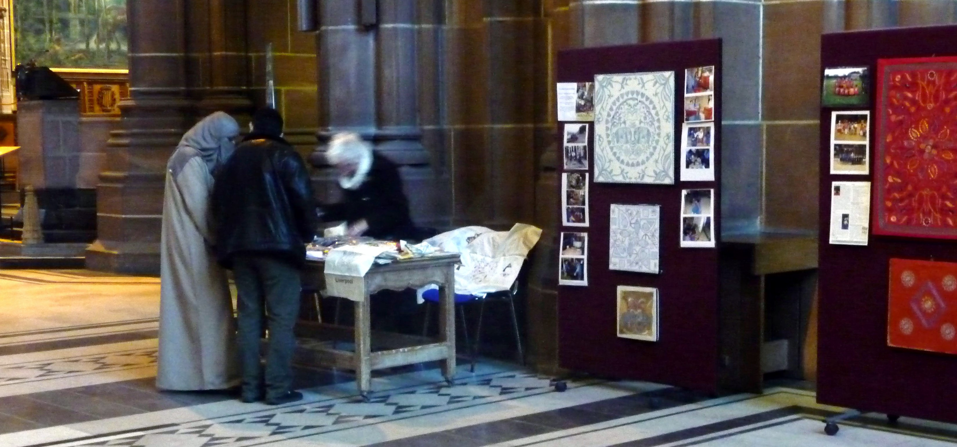Ruby Porter MBE with visitors from Saudi Arabia at her Sreepur stall in Liverpool Cathedral, March 2015