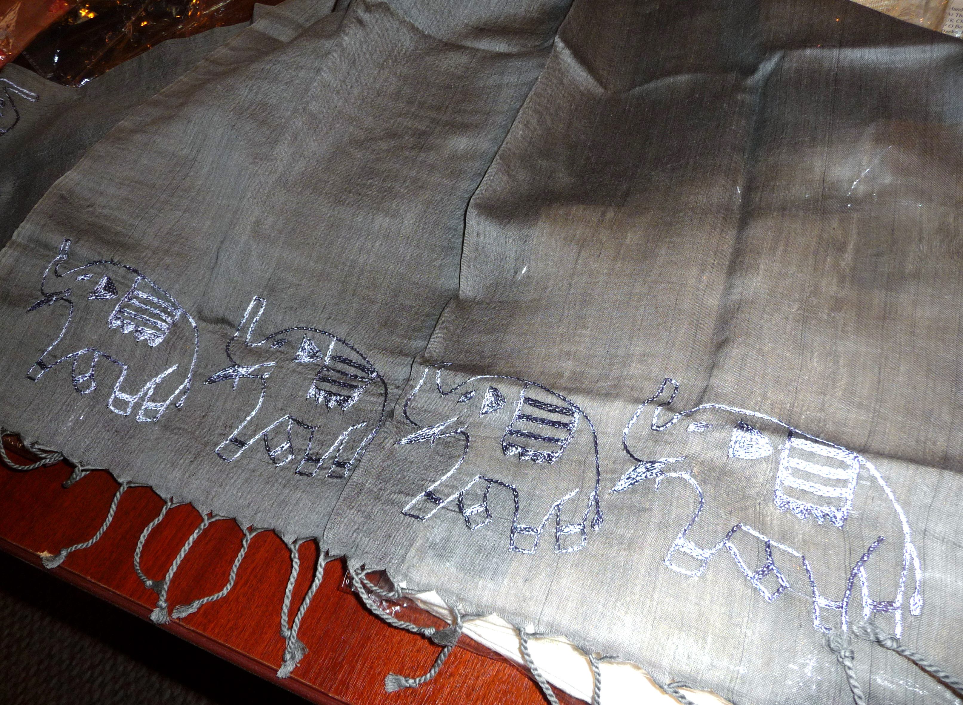 cotton/silk mixture scarf with embroidered elephants. Charcoal is used to dye this colour