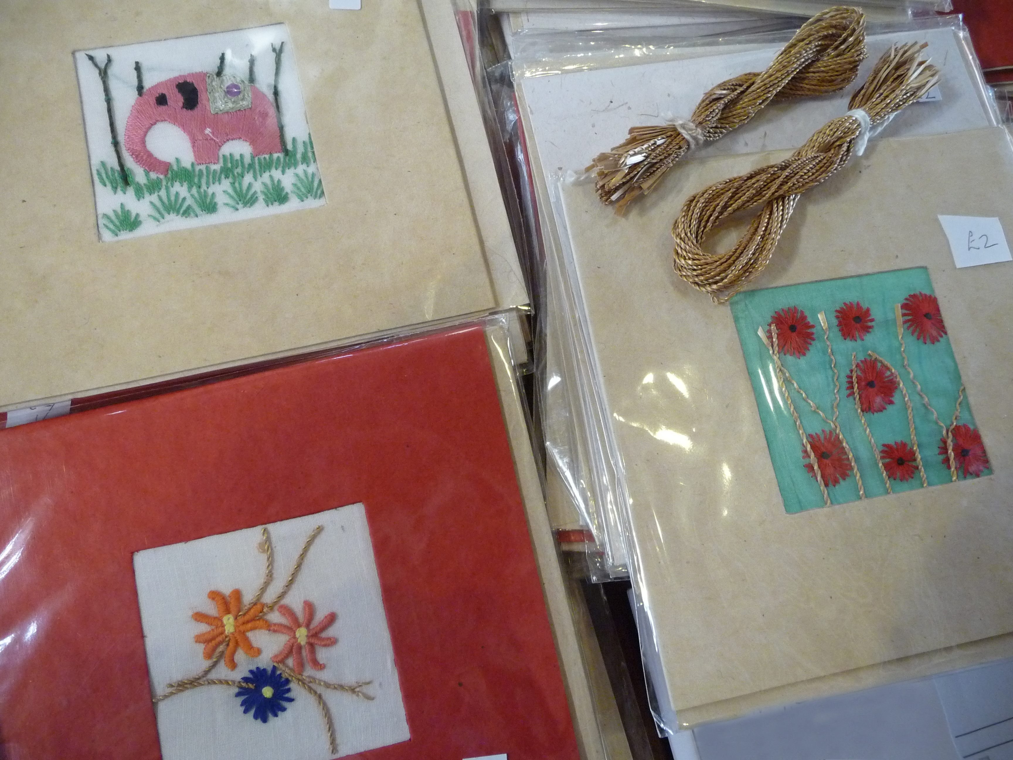 embroidered cards for sale which feature wheatstraw thread which has been spun in Sreepur Village, Bangladesh