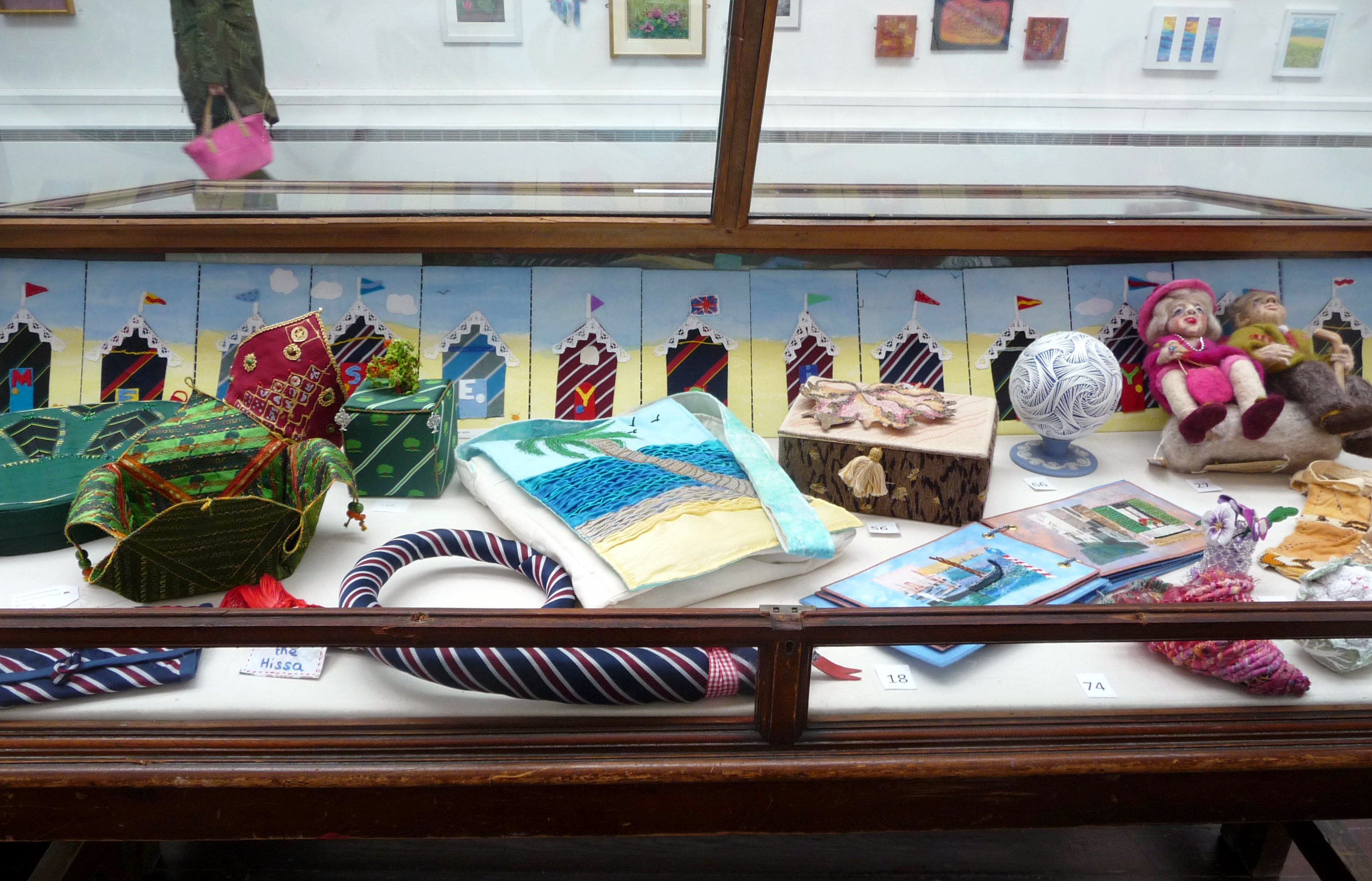 cabinet in Storey Gallery with BEACH HUTS by Merseyside YE Group, hand stitched concertina panel