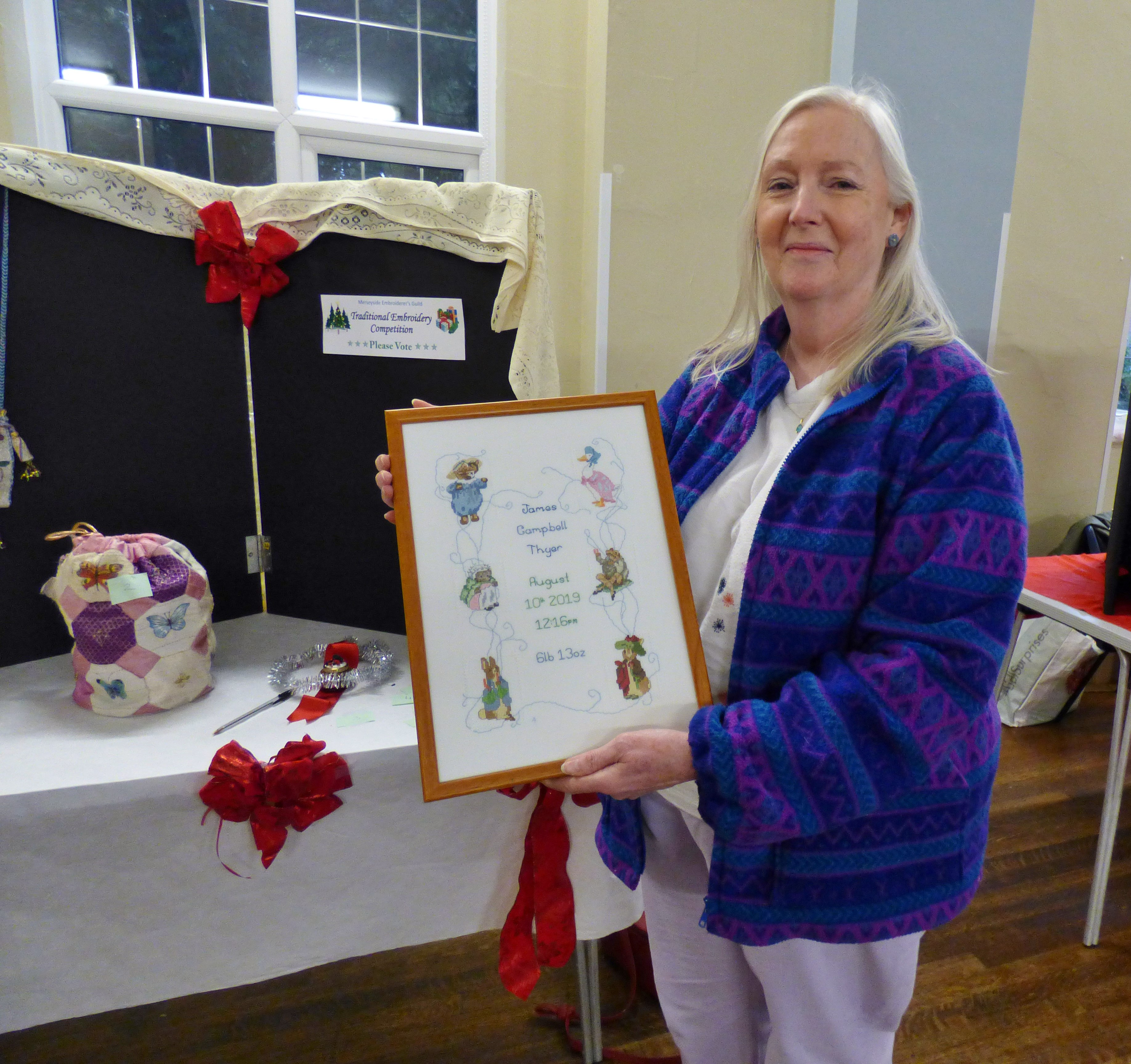 winner of 2019 Traditional Embroidery competition 2019 was Ann Thyer with her beautiful cross stitch birth sampler at MEG Christmas Party 2019