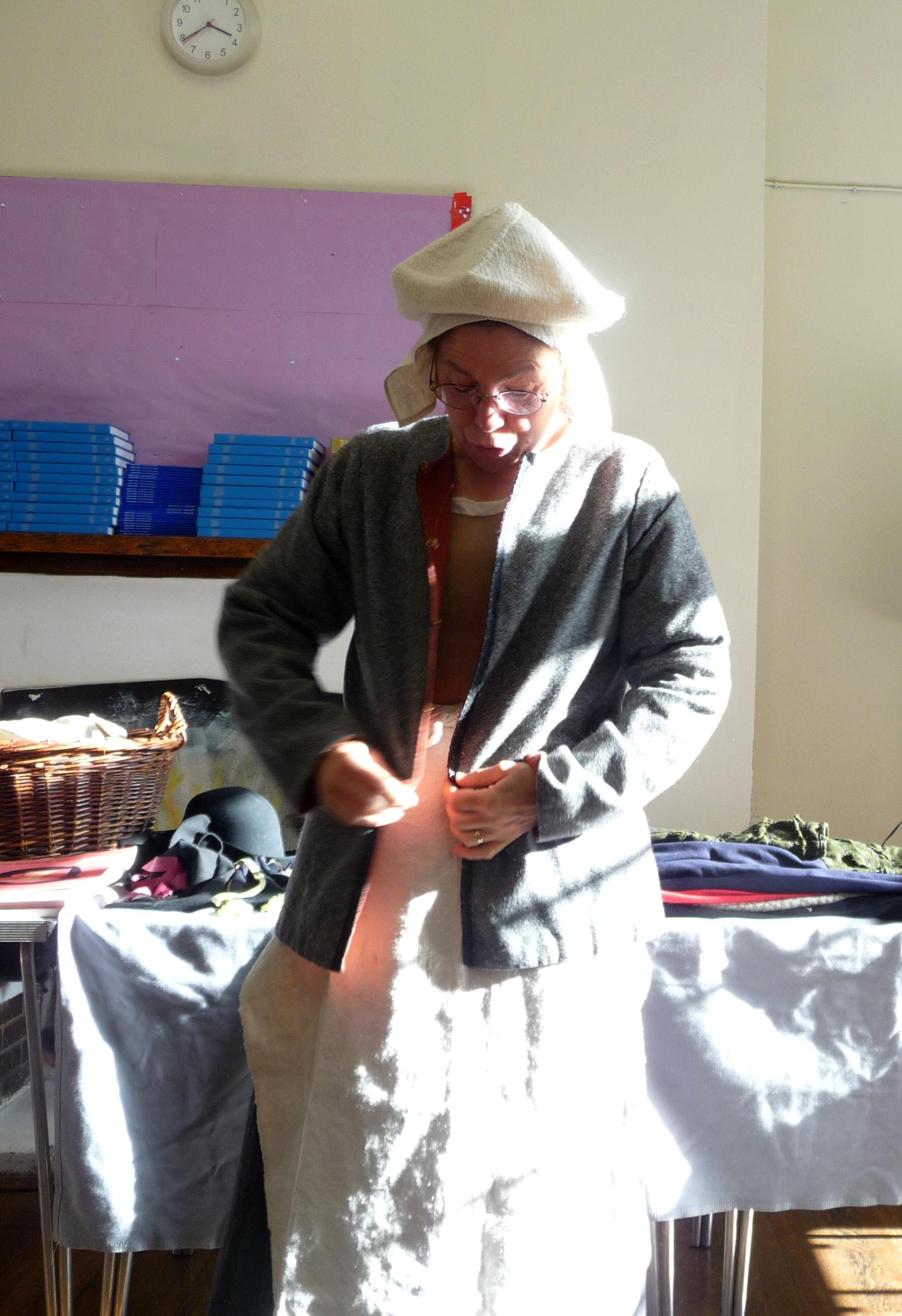 Tudor scummy waistcoat, woolen cap and coif