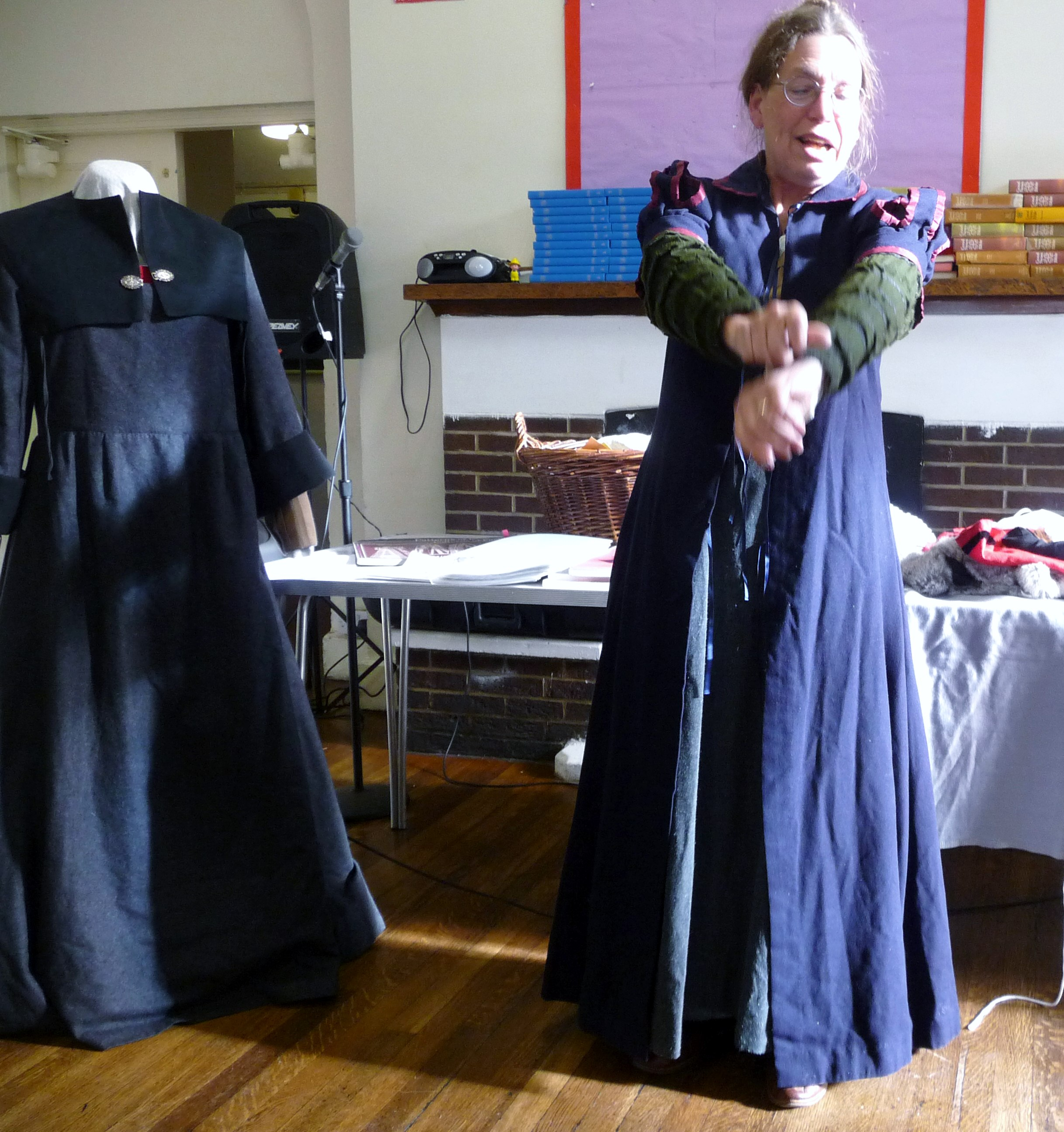 an English gown or cassock is worn over the 1578 sleeves