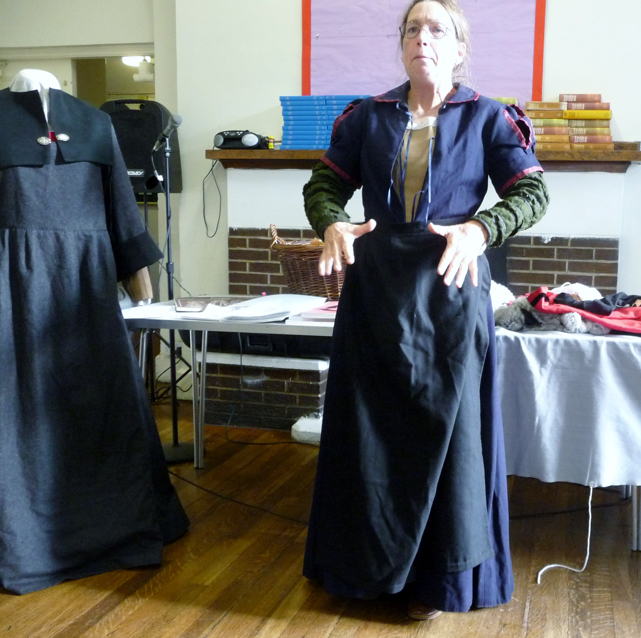 "Sarah Thursfield wears a black worsted apron which denotes the she is a ""clean servant"""
