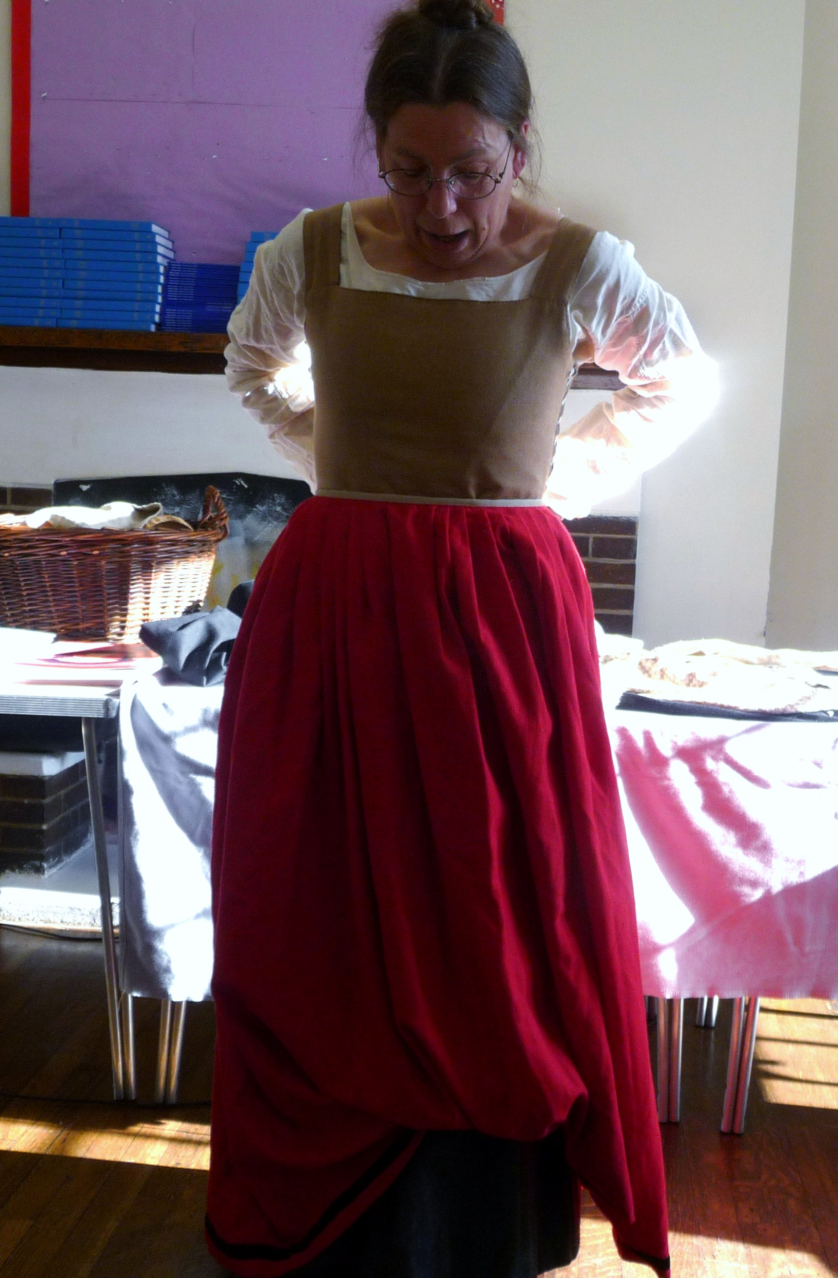 Sarah Thursfield is wearing a red half kirtle
