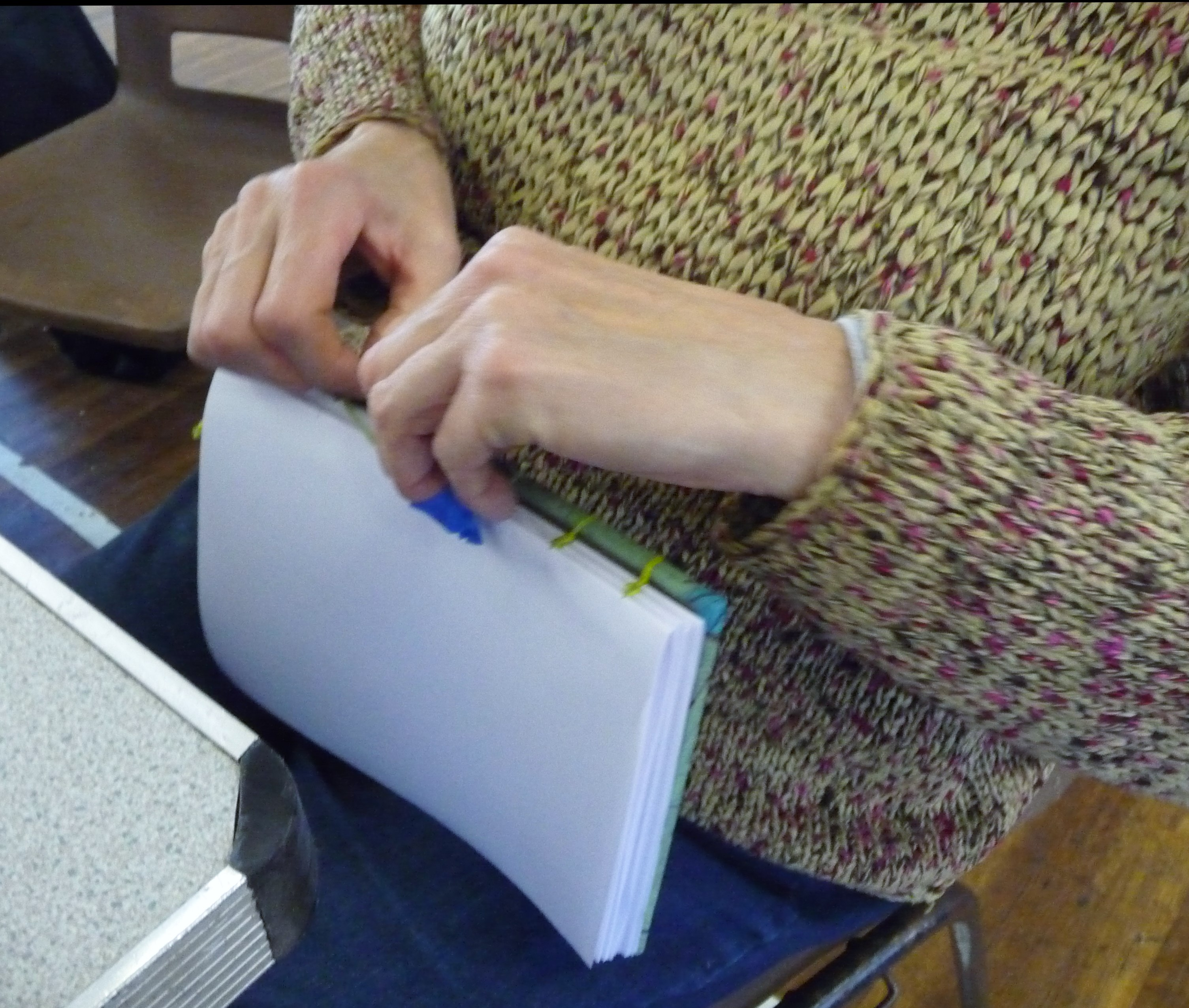 Bookbinding workshop- sititching the signatures to the cover