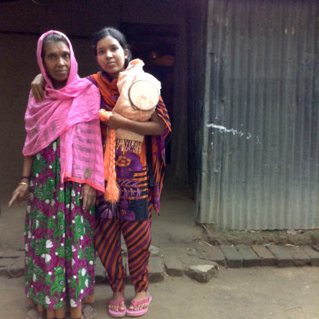 This is Shokina with her mother at home in Sreepur, Bangladesh. They make elephant embroideries which are sold in Britain to raise more funds for the upkeep of the village.