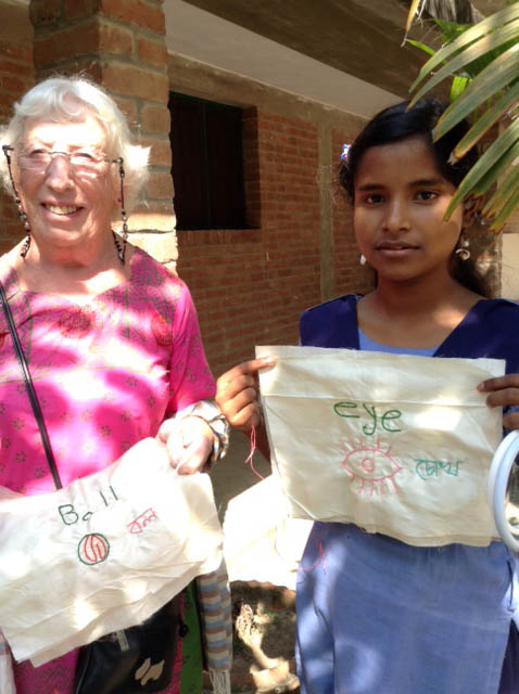 Ruby Porter MBE visiting the mothers with their embroidery in Sreepur Village, Bangladesh, 2014