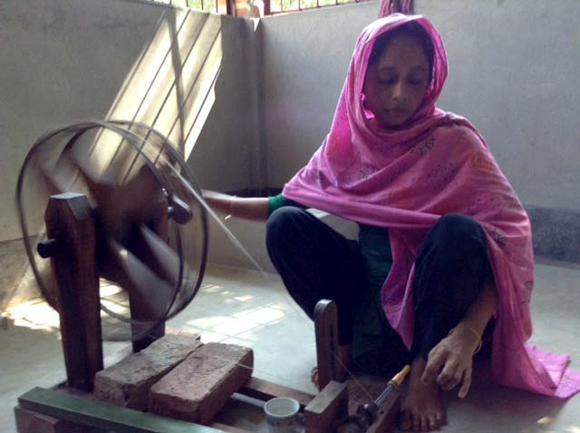 This is a mother spinning in Sreepur, Bangladesh
