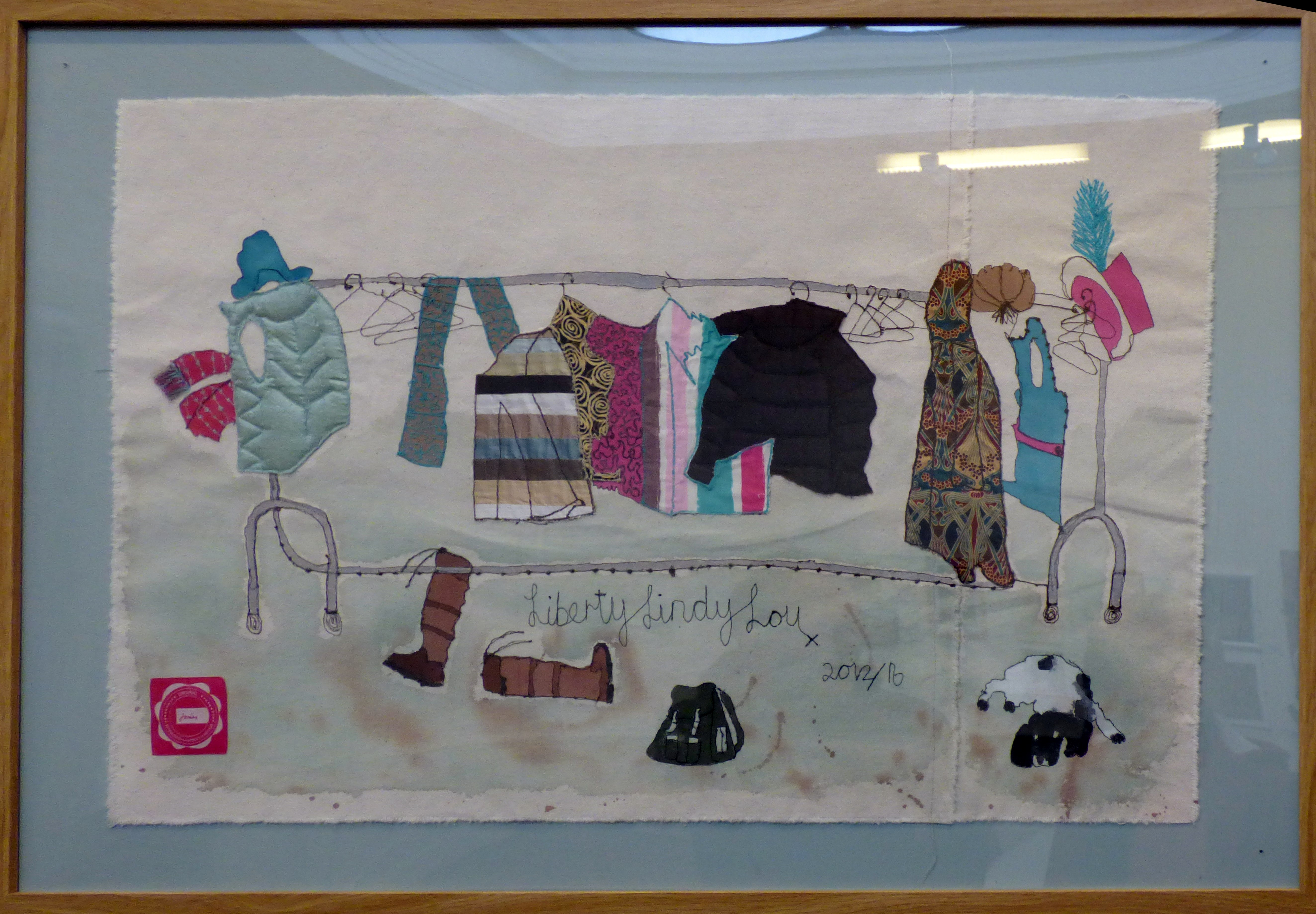 A CLOTHES RAIL by Linda Bassett, paint and machine embroidery