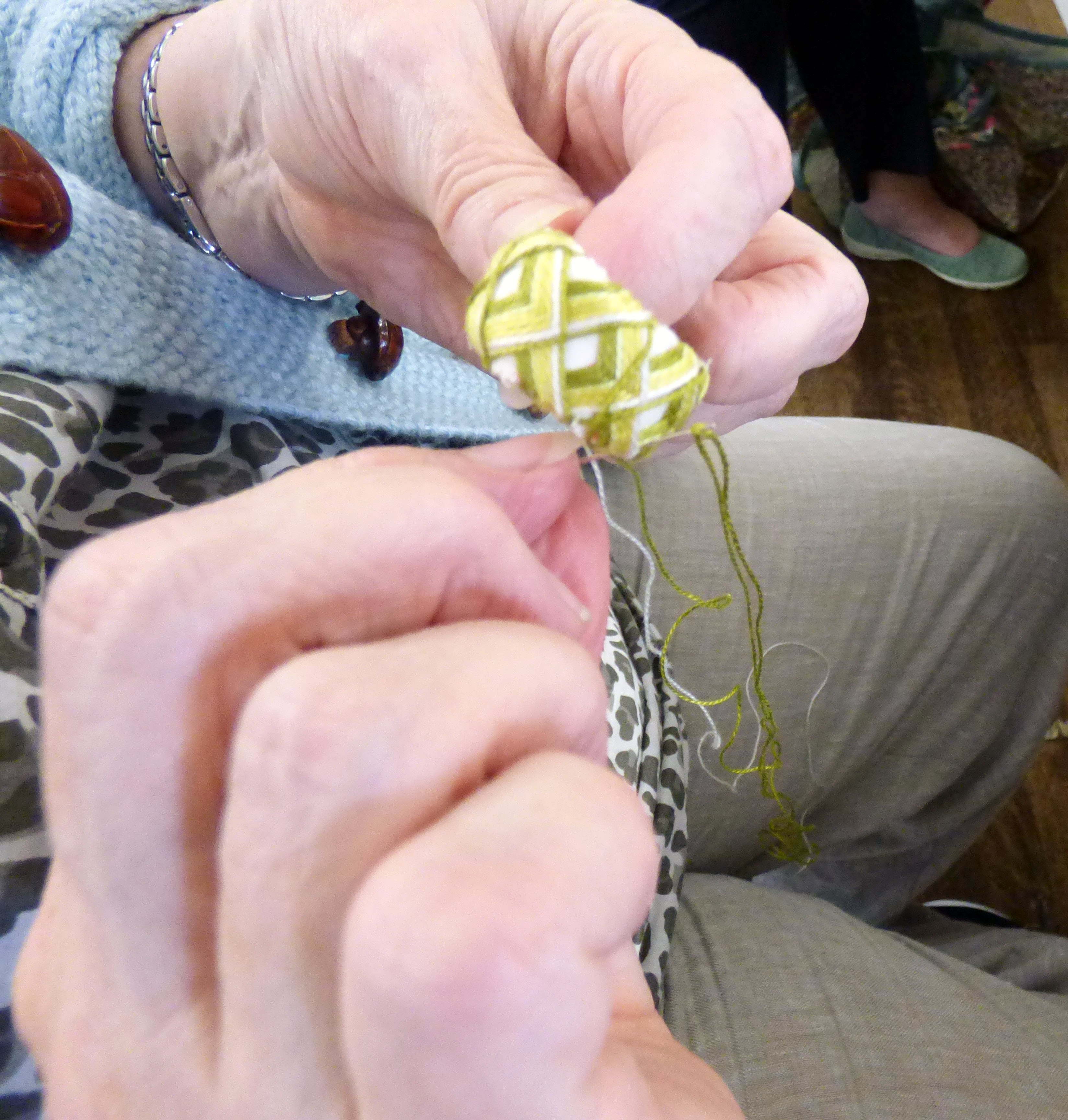 "stitching nearing completion at Kathryn Thompson's ""Japanese Thimbles"" workshop"