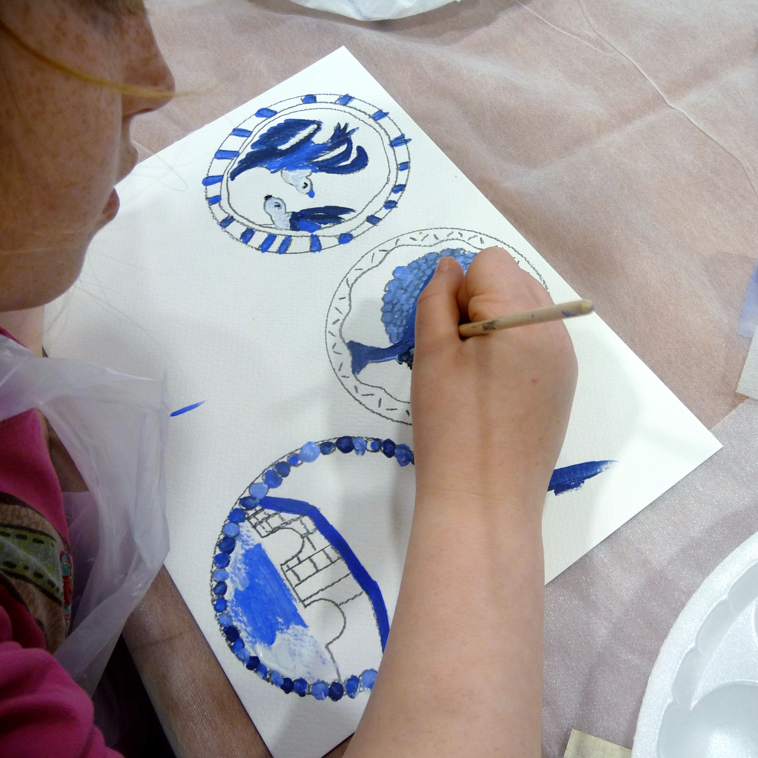 YE painted plates based on the willow pattern design